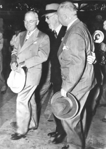 George Albert Smith, center, meets with U.S. President Harry S. Truman, at left, on June 26, 1945.