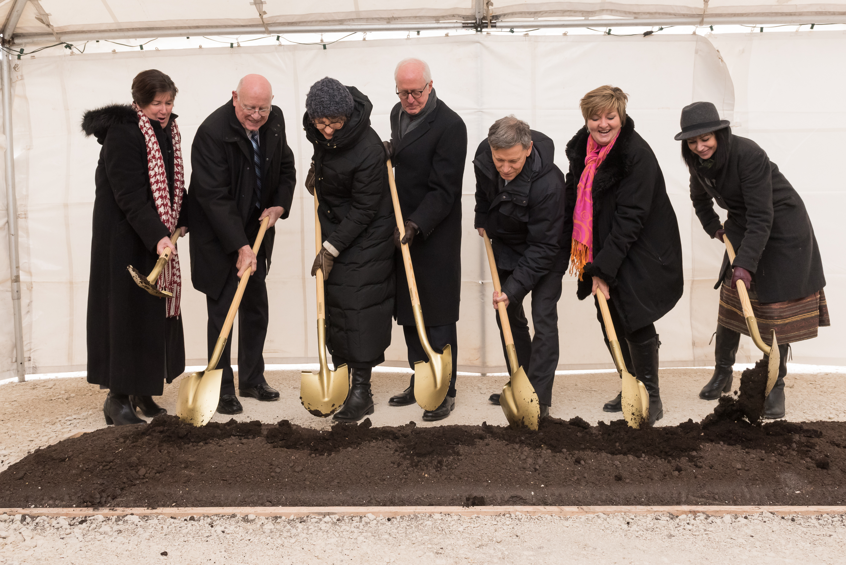 Elder Larry Y. Wilson, middle, leads the groundbreaking at the Winnipeg Manitoba Temple site on Dec. 3, 2016.