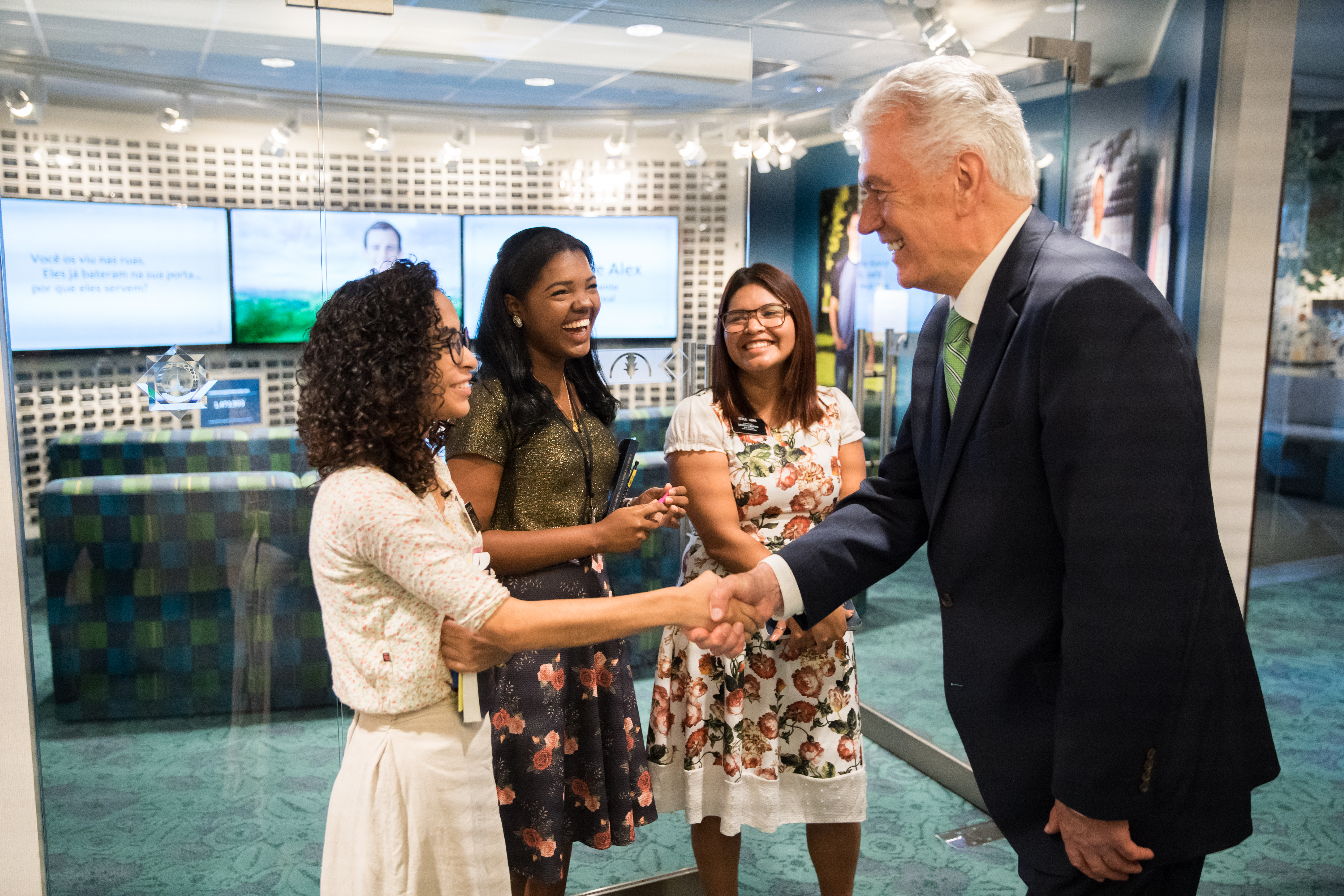 Elder Dieter F. Uchtdorf greets sister missionaries serving at the new Sao Paulo Brazil Temple Visitors' Center in February 2019.