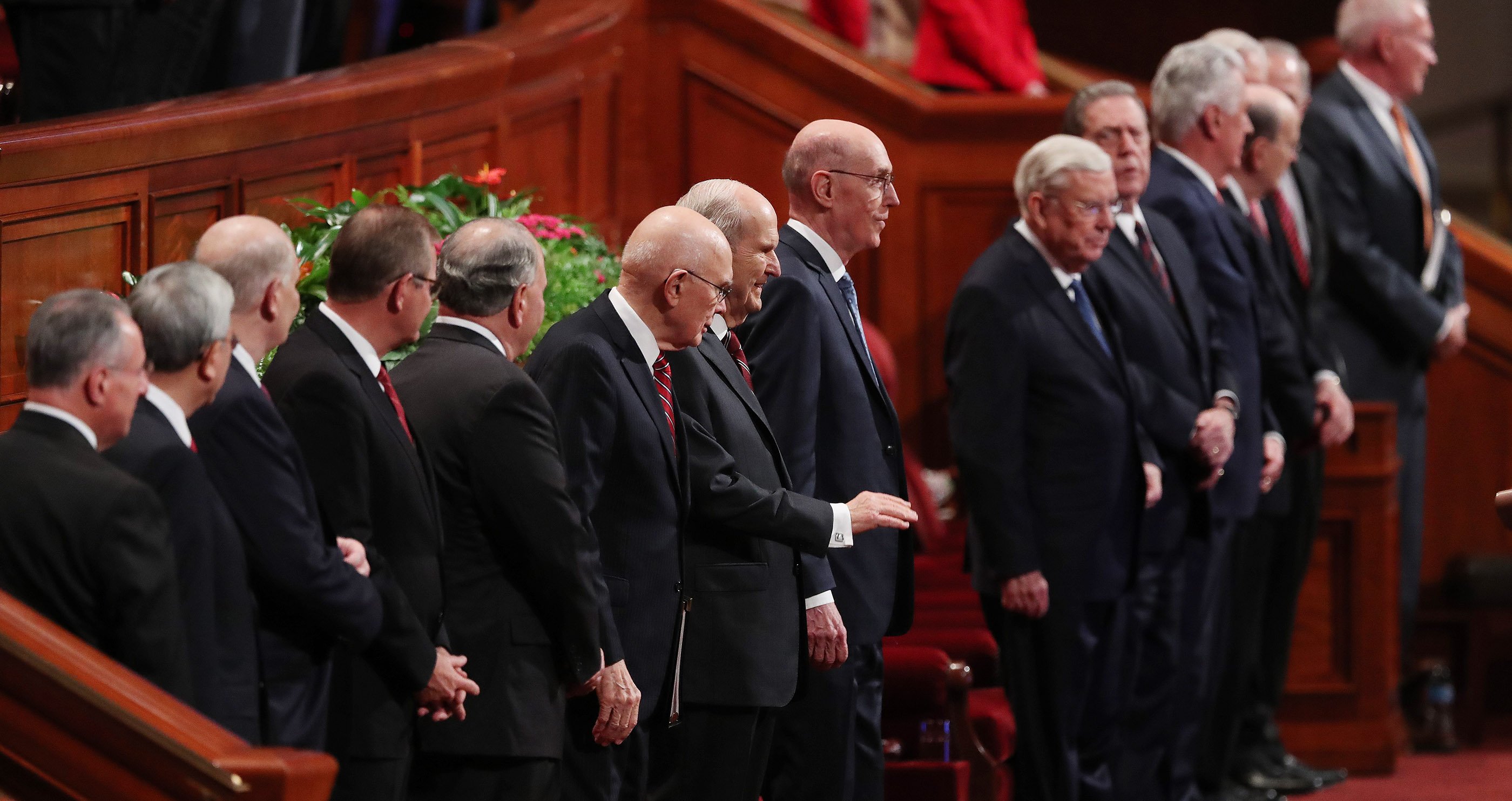 President Russell M. Nelson, center, the First Presidency and the Quorum of the Twelve Apostles stand as they enter the Conference Center in Salt Lake City for the Saturday afternoon session of the 188th Semiannual General Conference of The Church of Jesus Christ of Latter-day Saints in Salt Lake City on Saturday, Oct. 6, 2018.