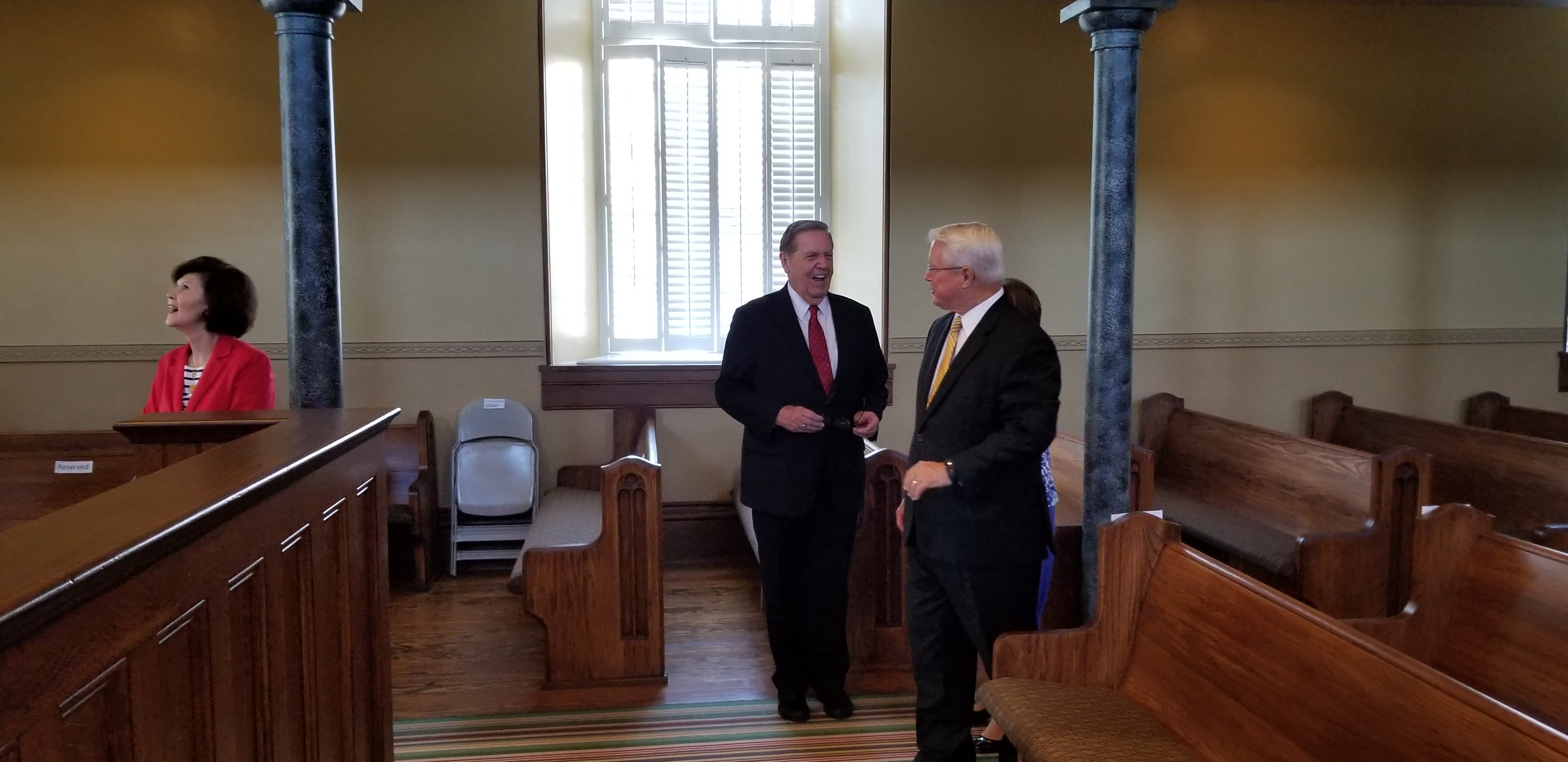 Elder Jeffrey R. Holland of the Quorum of the Twelve Apostles, center, visits with Bishop Dean M. Davies, right, first counselor in the Presiding Bishop, inside the St. George Tabernacle during a July 27, 2018, private tour of the building. Sister Patricia Holland, left, looks above to the tabernacle's rostrum and balconies.