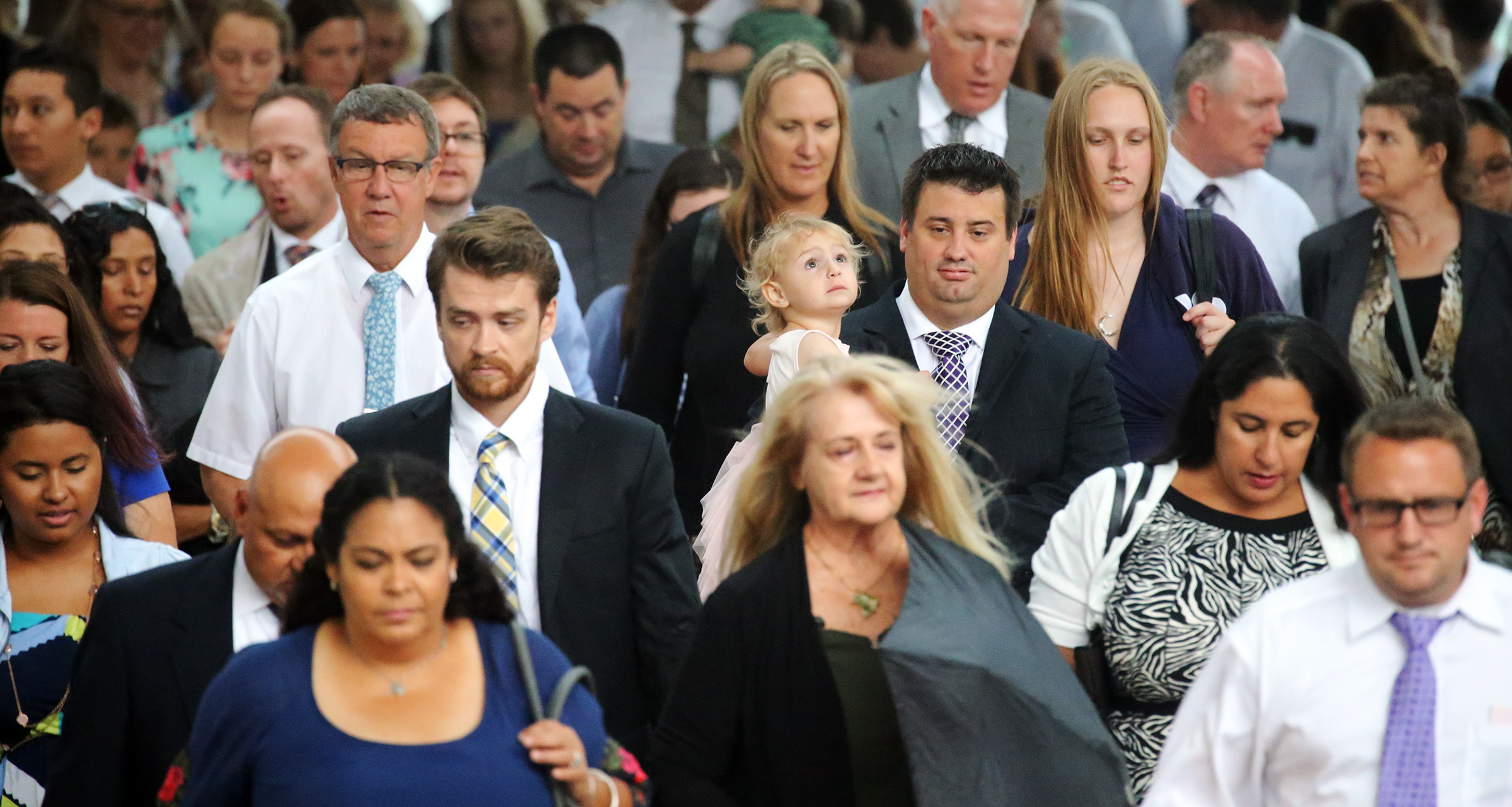 Devotional attendees make their way to listen to President Russell M. Nelson and others speak at the Amway Center on a June 9, 2019, in Orlando, Florida.