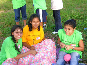 Young women join activities at youth camp in Belize. Youth can grow when adult advisers provide them with opportunities to lead.