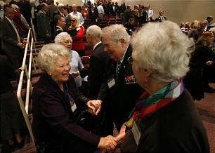 Nona Mower, left, talks with Virgil Kovalenko and Lela Kovalenko, right, after the keynote address given at the Saints at War conference Nov. 11.