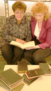 Rangi Parker, with associate Laurie Stephens, views collection of Elder Rufus K. Hardy.