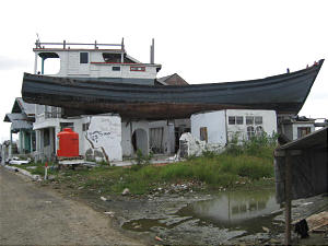 Boat remains on home -- located more than half a mile from the sea -- in Banda Aceh, 17 months after tsunami.