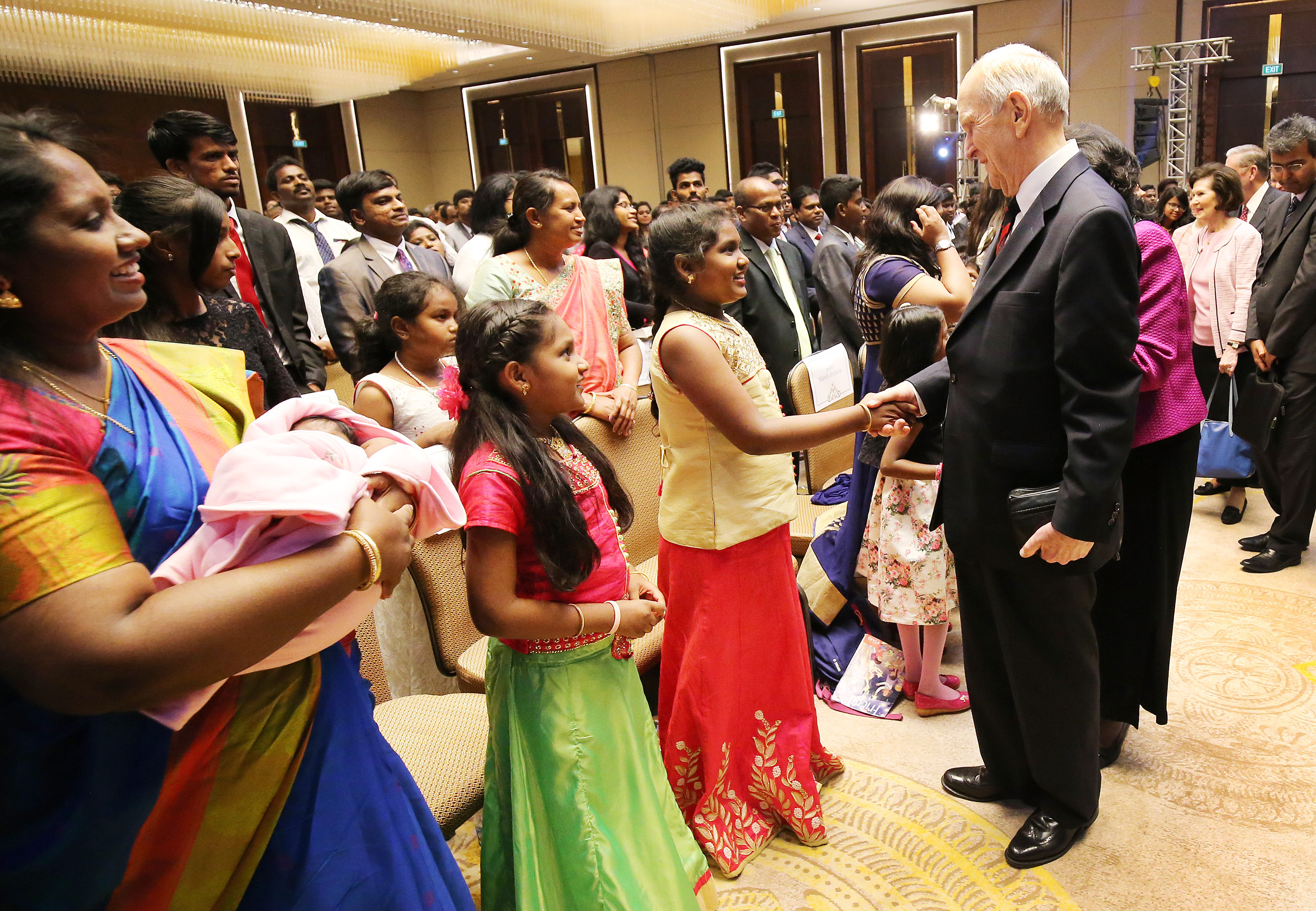 President Russell M. Nelson greets Nadine Sunderraj, Nathalee Sunderraj and their mother, Stella Sunderraj, after the devotional in Bengaluru, India, on Thursday, April 19, 2018.