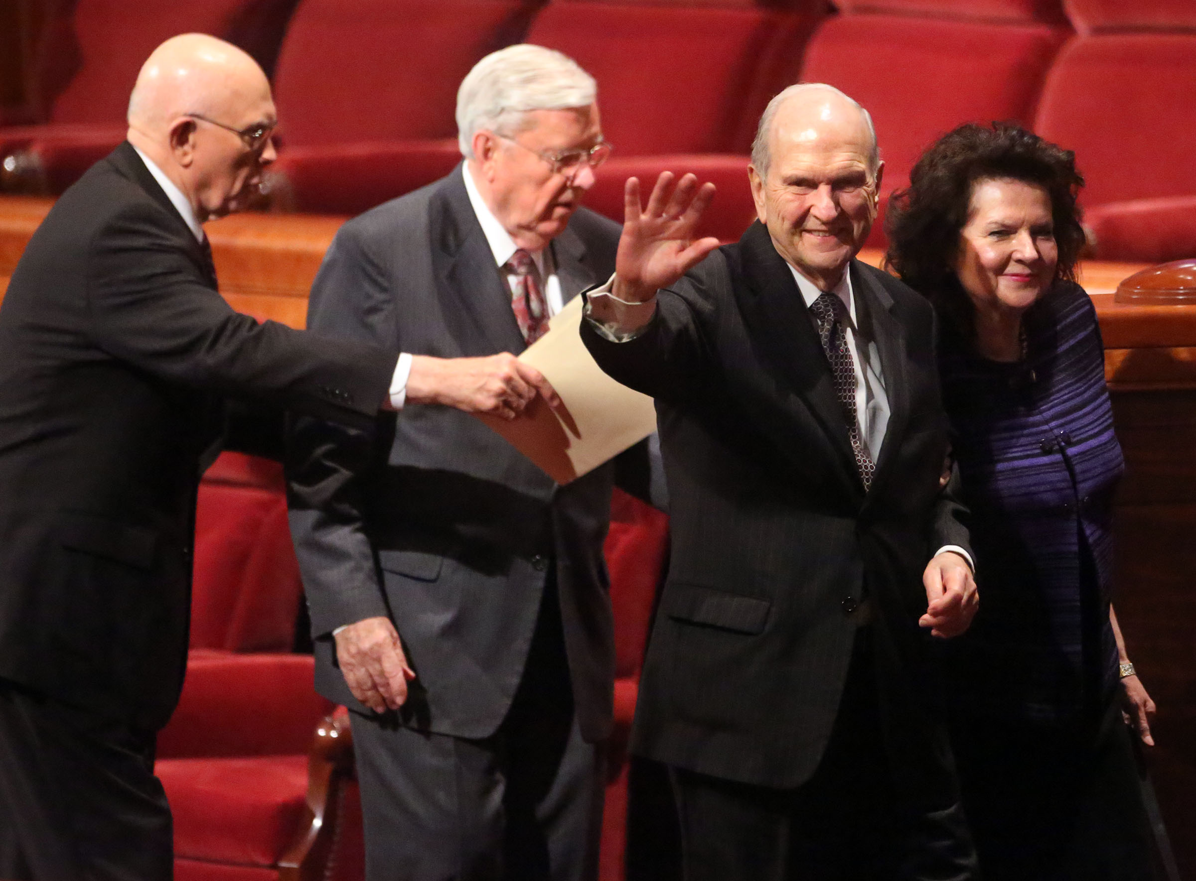 President Russell M. Nelson and his wife, Sister Wendy Watson Nelson, leave the stand after the Sunday morning session of general conference Sunday, April 3, 2016.