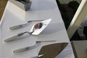 The U.S. flag if reflected in one of trowels used to place mortar during cornerstone ceremony at the Kansas City Missouri Temple dedication on May 6.