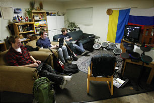 BYU students Matt McDonald, James Miller and Jordan McKee play games and study in the Russian House in the foreign language student residences at BYU.