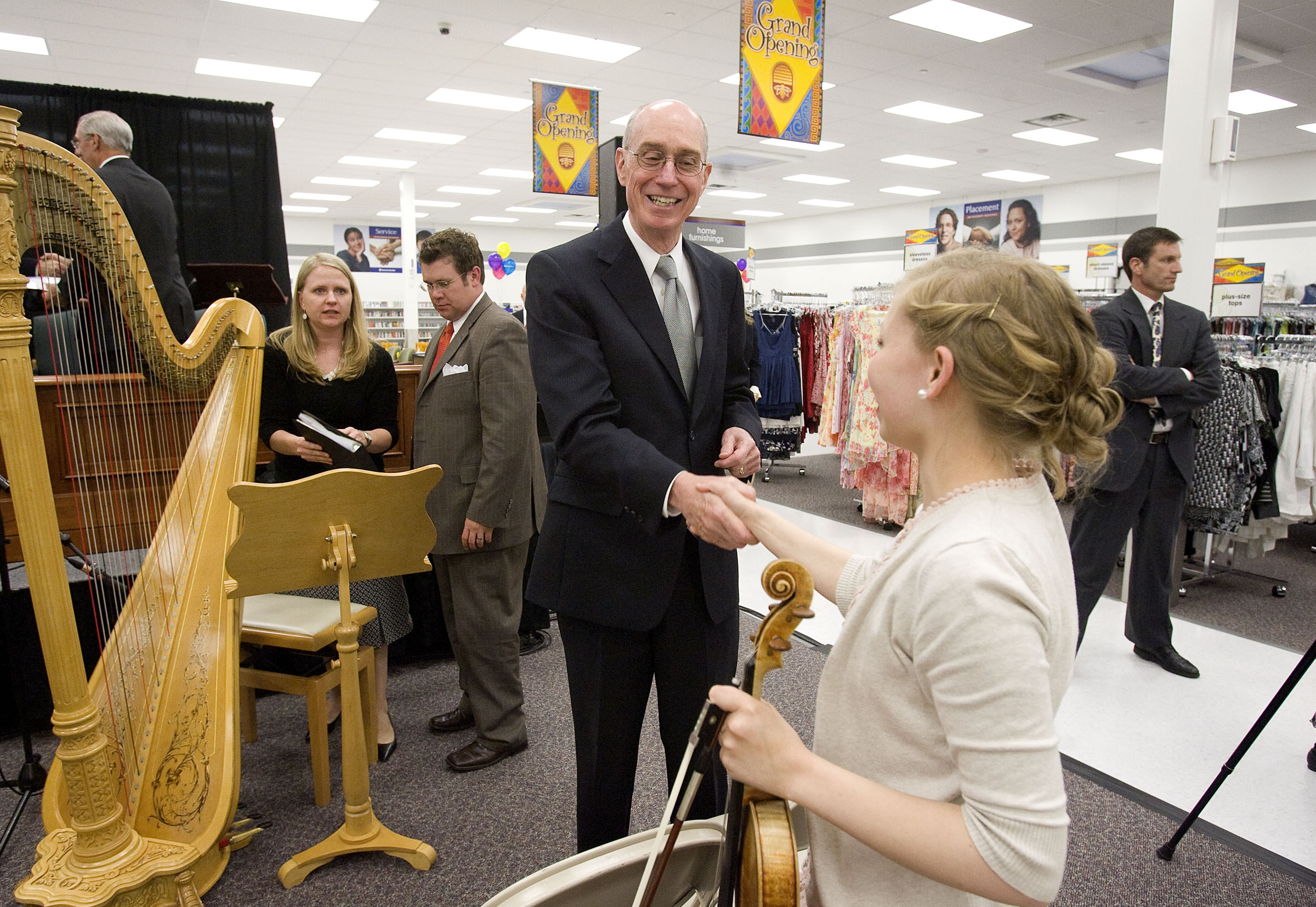 President Henry B. Eyring of the First Presidency of the Church of Jesus Christ of Latter-day Saints thanks violinist Emily Nelson, who performed during the program, after the Sugarhouse Welfare Facility Dedication services in Salt Lake City on Wednesday, June 8, 2011.