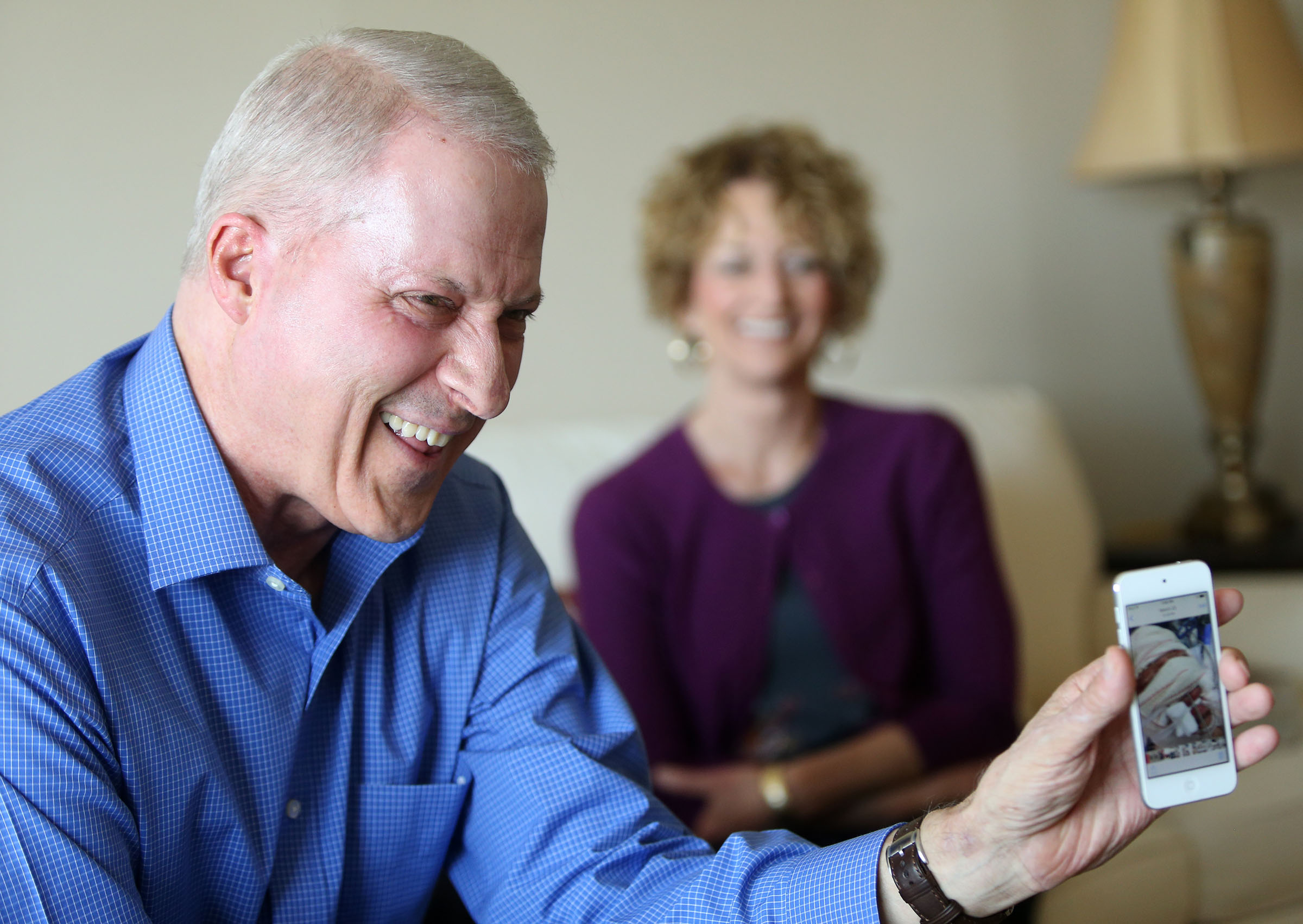 Richard Norby laughs at an unrecognizeable photo of himself from his time in the hospital recovering from the March terrorist attack on the Brussels airport at home in Salt Lake City on Wednesday, July 27, 2016. Norby was in Brussels serving a mission for the Church of Jesus Christ of Latter Day Saints. (Photo: Kristin Murphy, Deseret News) (Photo: )