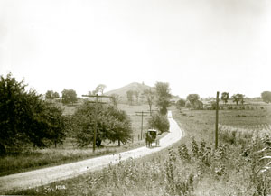 Except for the utility poles, this horse-drawn carriage on the dirt road leading from the Hill Cumorah in the early 1900s is reminiscient of the setting and scenes the Prophet Joseph would have known in the early 1800s.