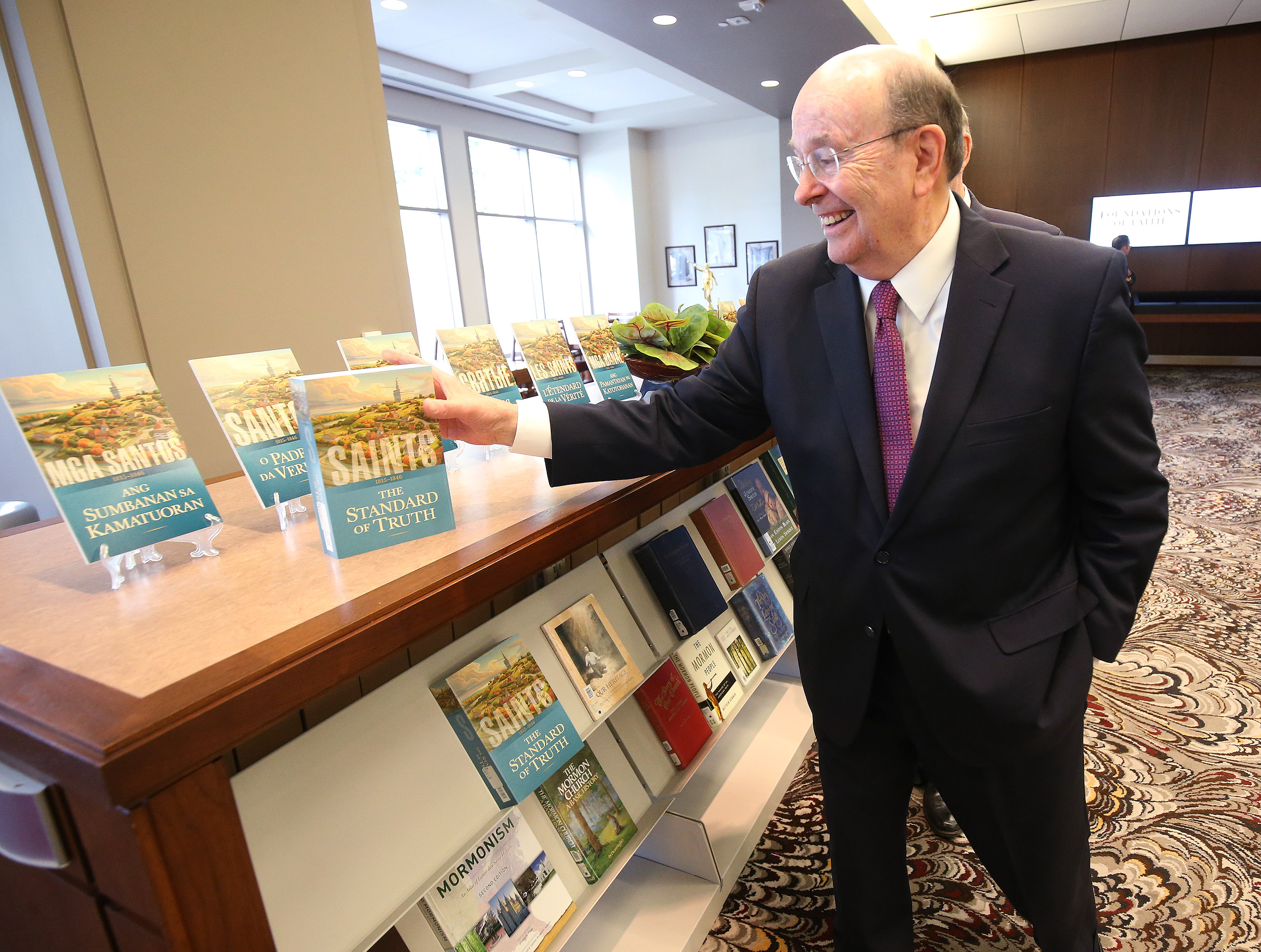 """Elder Quentin L. Cook of the Quorum of the Twelve Apostles looks over """"Saints: The Story of The Church of Jesus Christ in the Latter Days"""" in Salt Lake City on Tuesday, Sept. 4, 2018."""