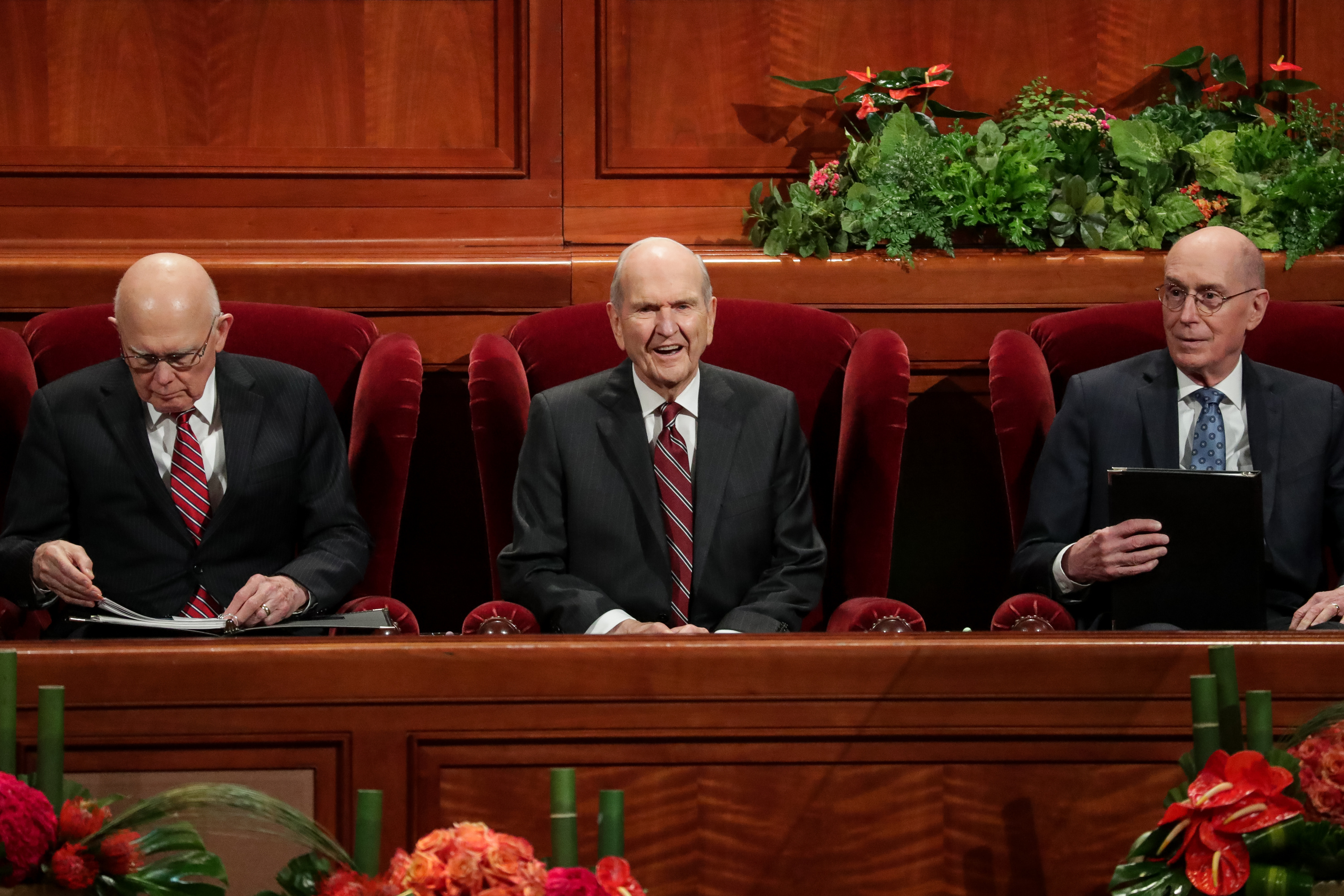 President Russell M. Nelson, center, President Dallin H. Oaks, first counselor in the First Presidency, left, and President Henry B. Eyring, second counselor in the First Presidency, right, take their seats for the Saturday afternoon session of the 188th Semiannual General Conference of The Church of Jesus Christ of Latter-day Saints at the Conference Center in Salt Lake City on Saturday, Oct. 6, 2018.