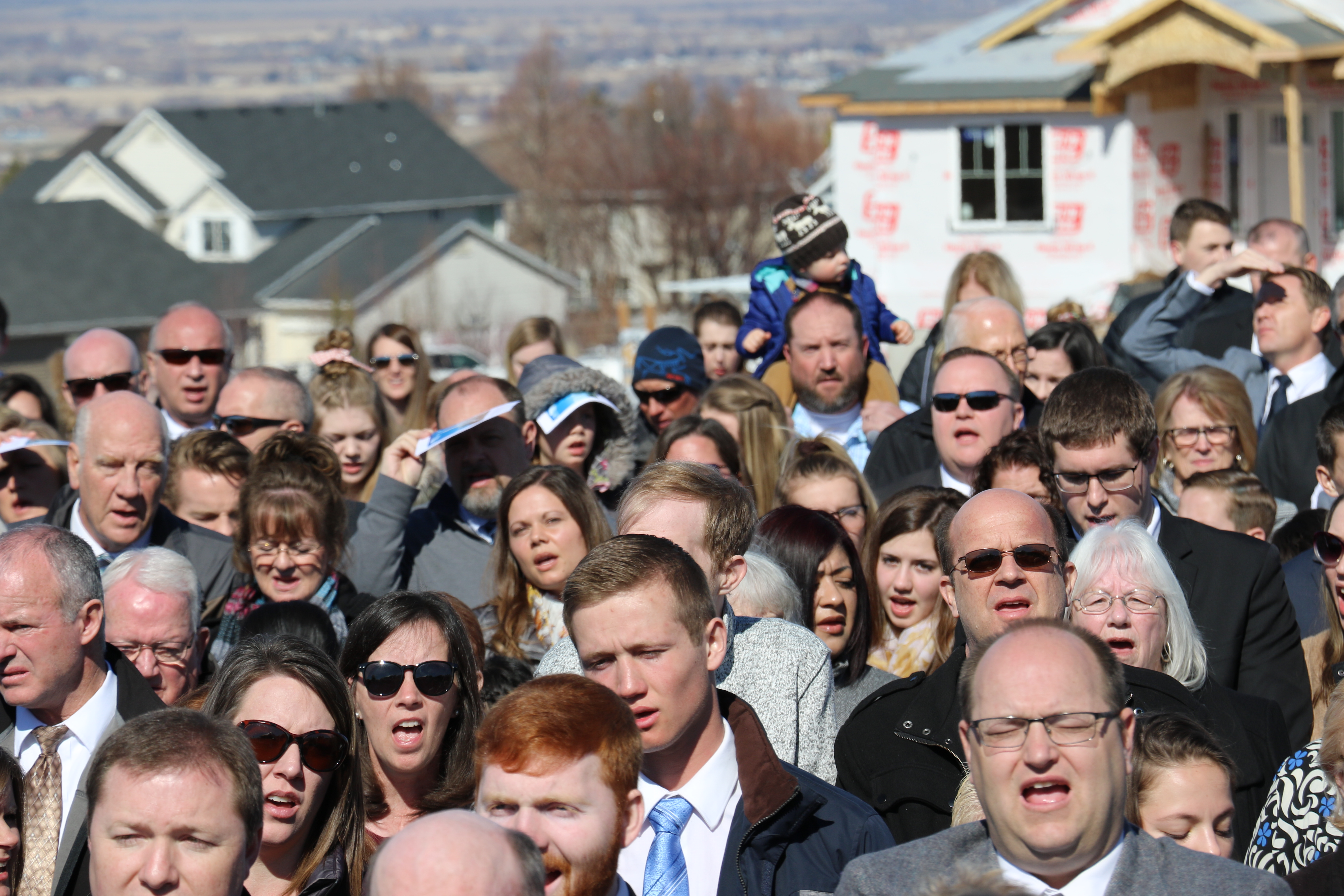 """Scores sing the closing hymn — """"The Spirit of God"""" — at the conclusion of the March 16, 2019, groundbreaking service of the Pocatello Idaho Temple."""
