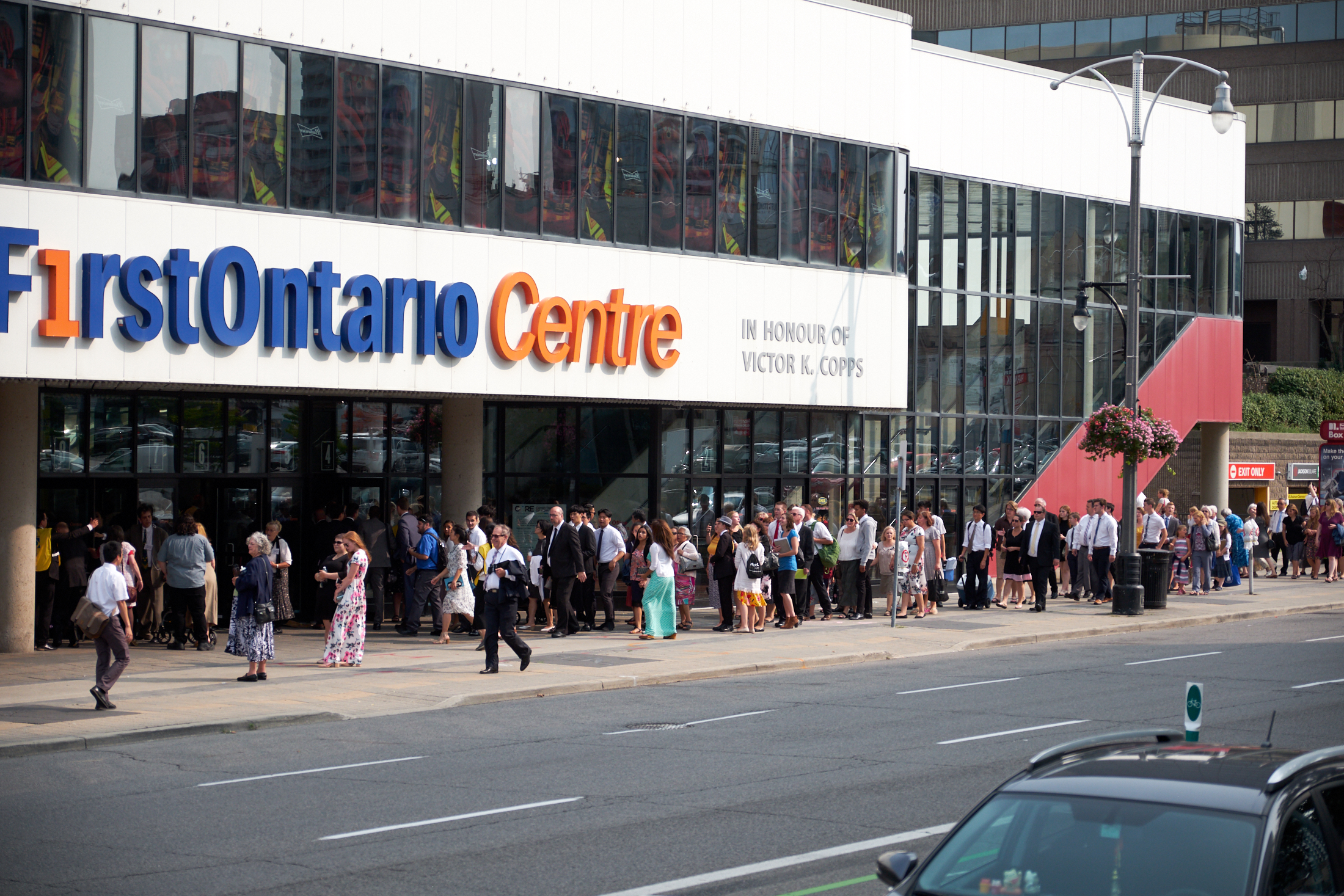 Members line up outside the FirstOntario Centre in Hamilton, Ontario, for a devotional with President Russell M. Nelson and his wife, Sister Wendy Nelson, on Sunday, Aug. 19, 2018.