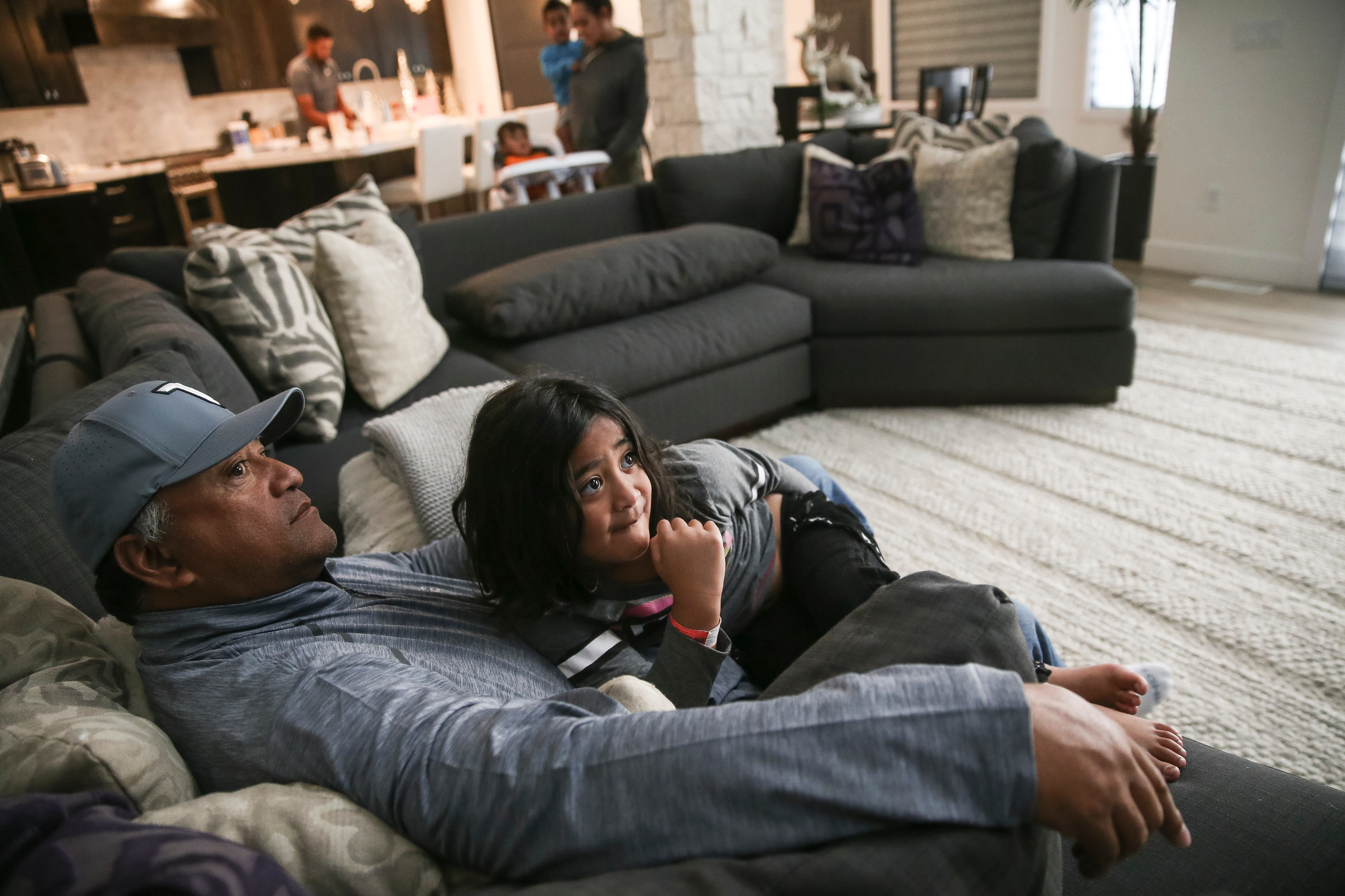 Kelepi Finau, father of PGA golfer Tony Finau, watches a movie with his granddaughter, Leilene, 5, at Tony's home in Lehi on Tuesday, Feb. 6, 2018. Leilene is Tony's daughter.