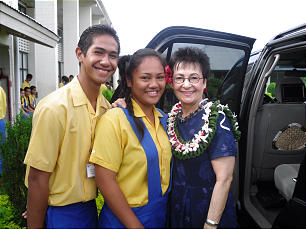 Sister Harriet Uchtdorf makes a pair of new friends at the Church-owned college in Pesega, Samoa. The visit of President and Sister Uchtdorf was comforting for members and non members of the Church.
