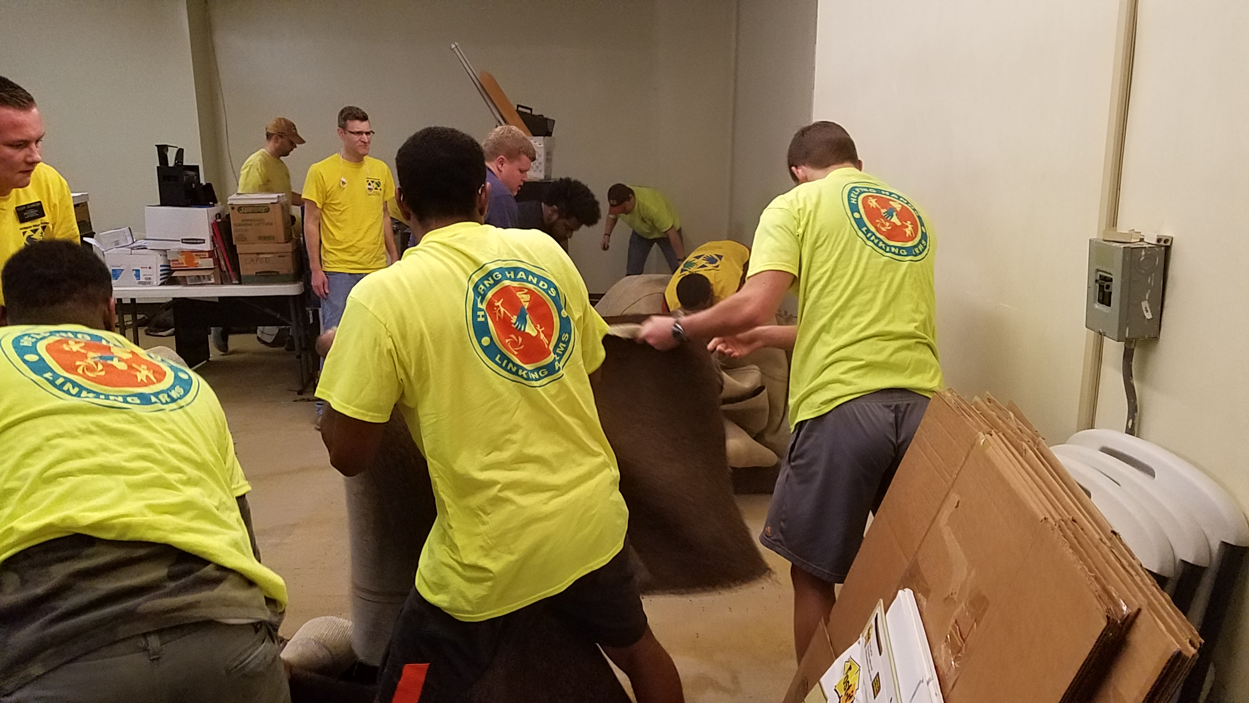 Full-time LDS missionaries help refurbishment NAACP offices in Jackson, Mississippi, in February 2018. They worked shoulder-to-shouder with local young single adult members.