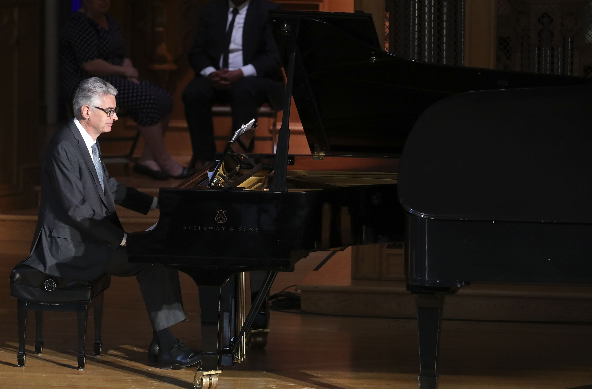 Presiding Bishop Gérald Caussé plays a piano duet with Nicolas Giusti after speaking to LDS Business College students during a devotional at Assembly Hall on Temple Square in Salt Lake City on Tuesday, Sept. 25, 2018.