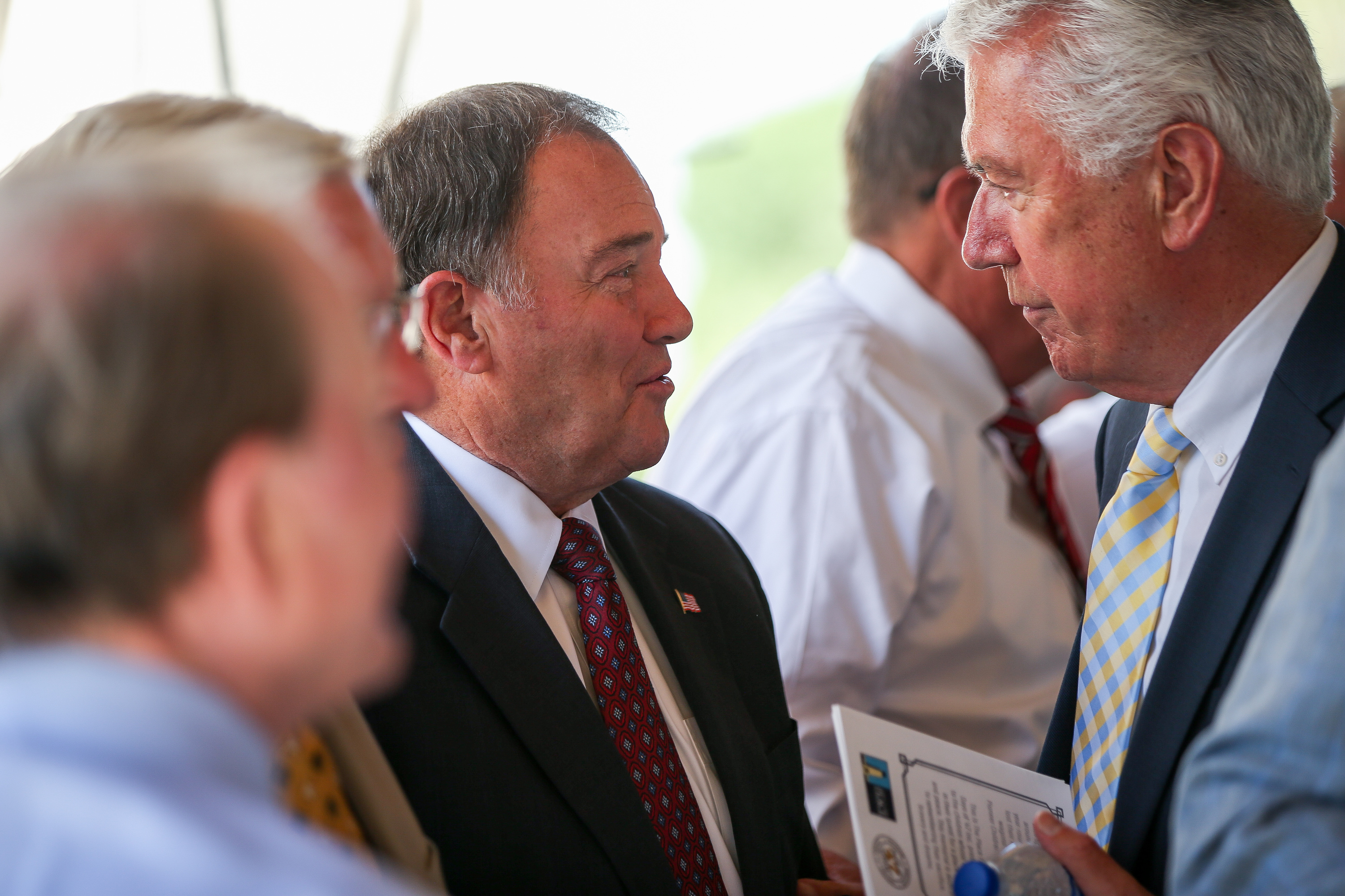 Gov. Gary Herbert, center, talks with Elder Dieter F. Uchtdorf of the Quorum of the Twelve Apostles of The Church of Jesus Christ of Latter-day Saints, right, at the dedication of the Children's Pioneer Memorial at This Is the Place Heritage Park in Salt Lake City on Saturday, July 20, 2019.