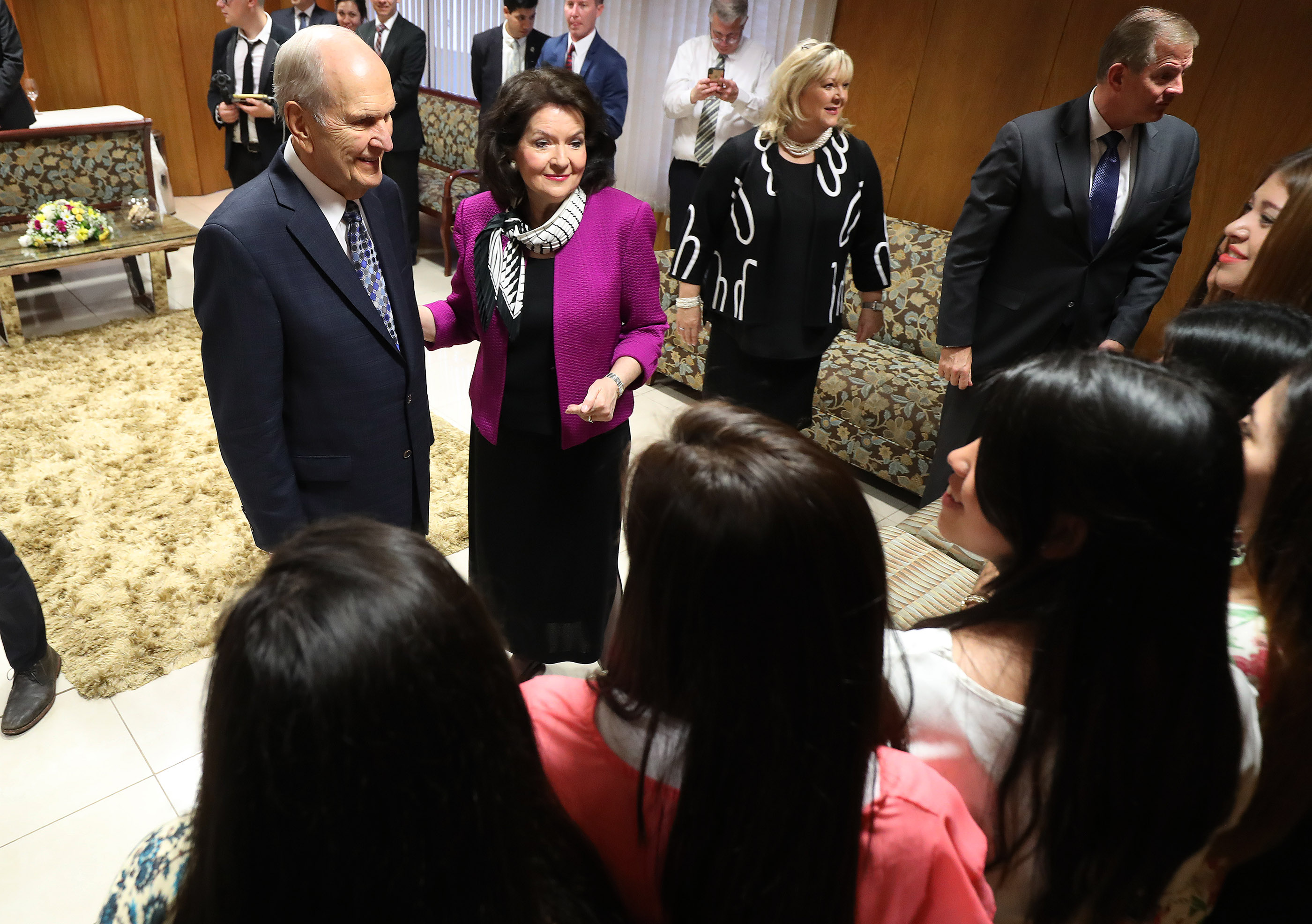 President Russell M. Nelson of The Church of Jesus Christ of Latter-day Saints and his wife, Sister Wendy Nelson, along with Elder Gary E. Stevenson, of the Quorum of the Twelve Apostles and his wife, Sister Lesa Stevenson, talk with youth prior to a devotional in Asuncion, Paraguay, on Monday, Oct. 22, 2018.