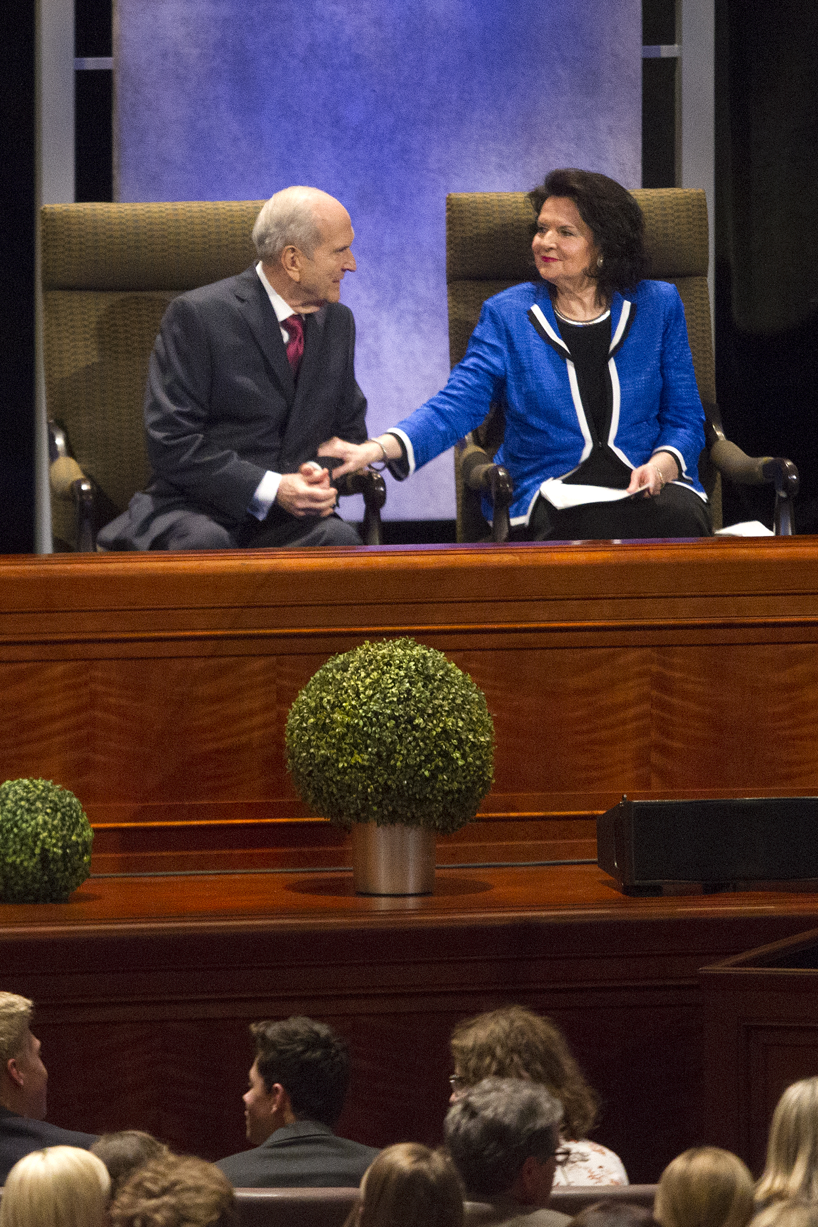 President Russell M. Nelson of The Church of Jesus Christ of Latter-day Saints sits with his wife, Sister Wendy Nelson, during the Worldwide Youth Devotional at the Conference Center in Salt Lake City on Sunday, June 3, 2018.