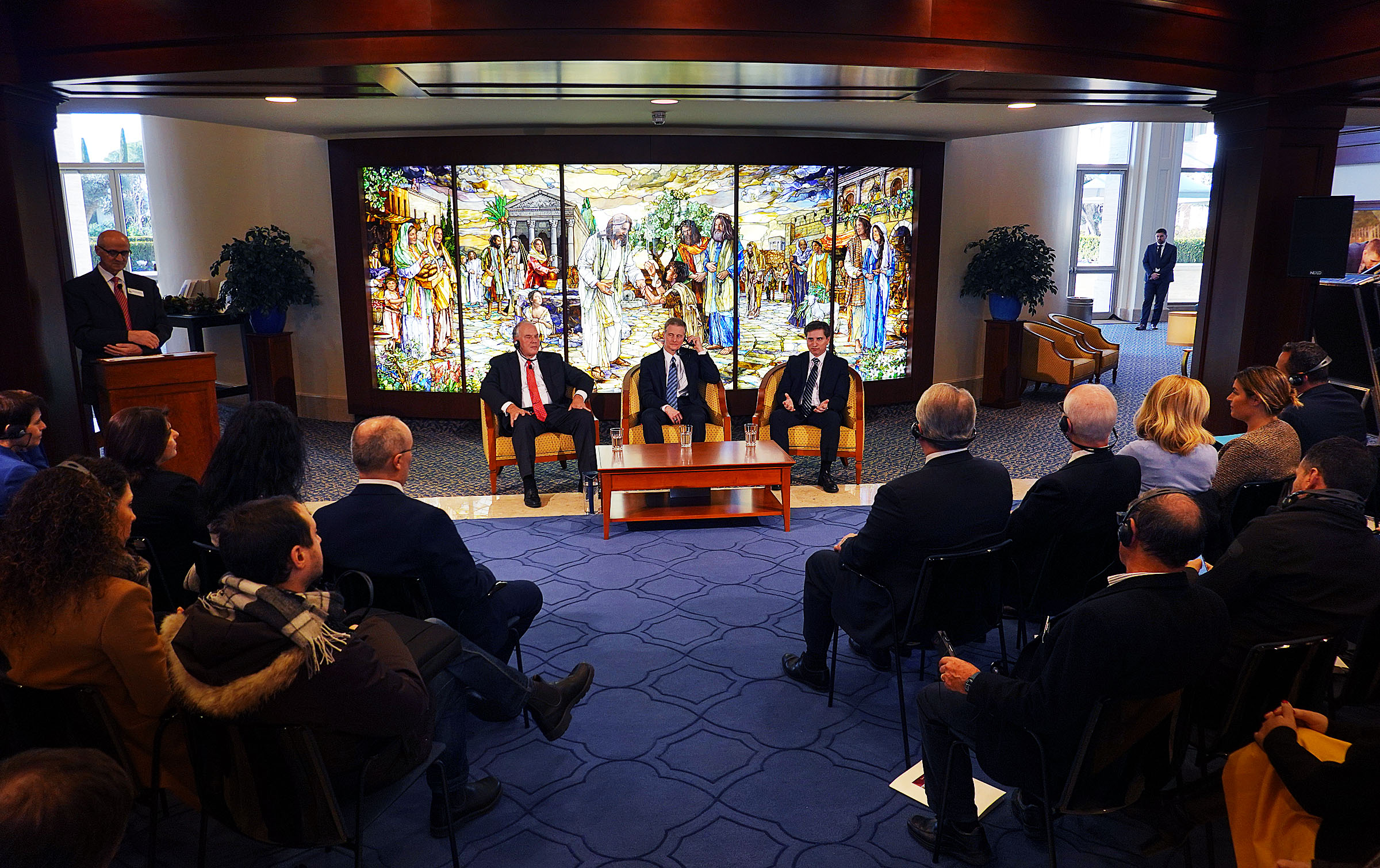 Elder Ronald A. Rasband, left, and Elder David A. Bednar of the Quorum of the Twelve Apostles, along with Elder Massimo De Feo, a General Authority Seventy, participate in a news conference in the Rome Italy Temple Visitors' Center on Monday, Jan. 14, 2019.