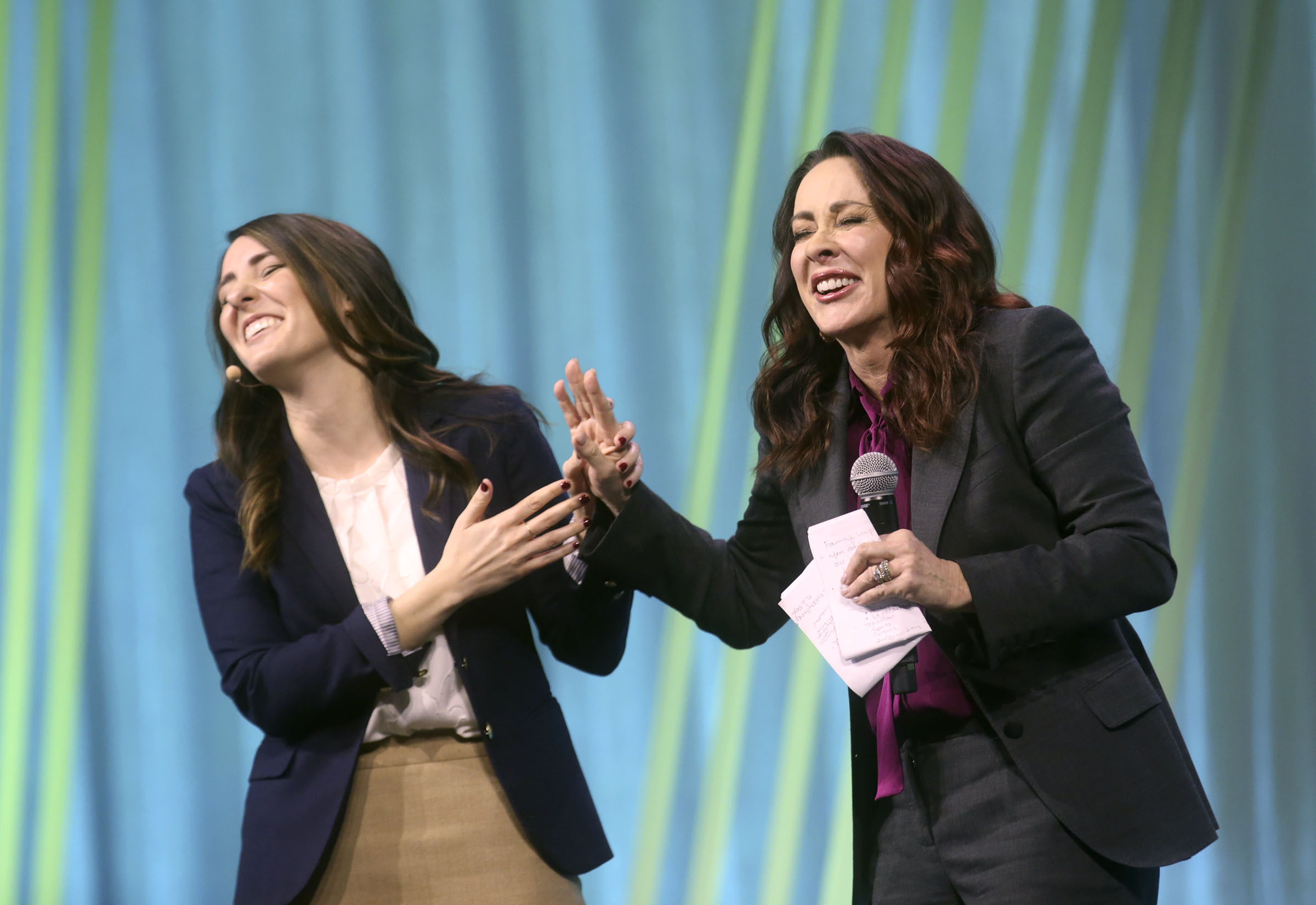 Actress Patricia Heaton, right, reacts as Whitney Peterson, Family Search UK records specialist, reveals some of Heaton's family history during RootsTech at the Salt Palace Convention Center in Salt Lake City on Feb. 28, 2019.