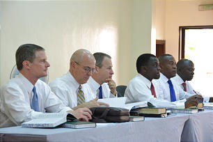 Elder David A. Bednar of the Quorum of the Twelve, Elder L. Whitney Clayton of the Presidency of the Seventy, Elder LeGrand R. Curtis Jr. of the Seventy and Africa West Area president sit with other leaders during a meeting held in Port Harcourt, Nigeria.