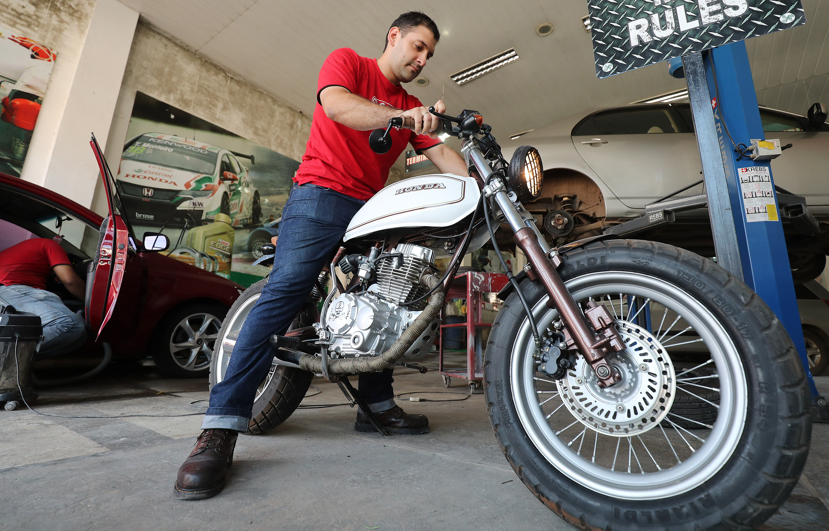 Bishop Lorenzo Britez fires up his motorcycle at his car wash and auto body store in Asuncion, Paraguay, on Monday, Oct. 22, 2018. Bishop Britez took Self Reliance courses offered by the Church to help with his business skills.