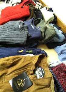 Sweaters and shirts, some of them brand new, were available for the needy at the service activity.