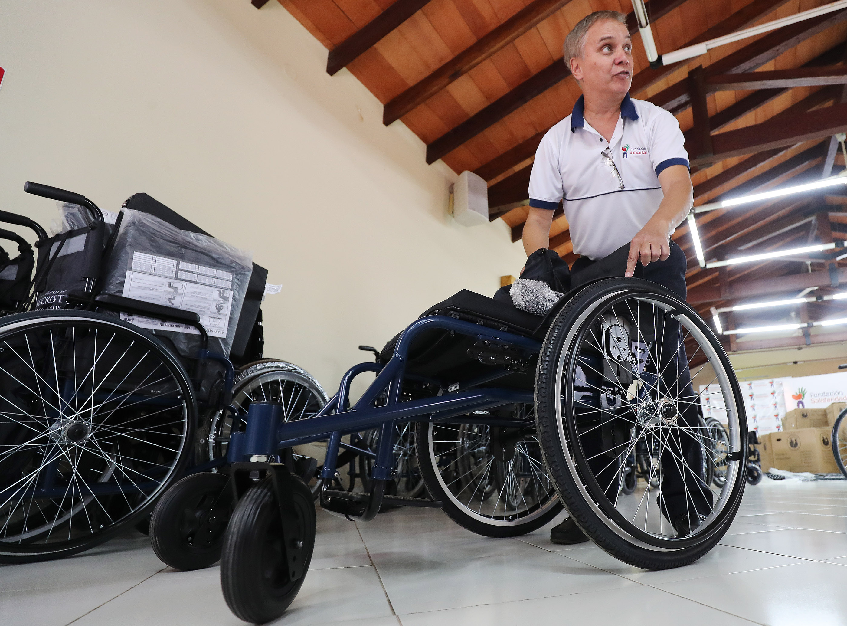 Oscar Corso, Foundation Solaridad, shows one of thousands of wheelchairs donated by LDS Charities in Asuncion, Paraguay, on Monday, Oct. 22, 2018.