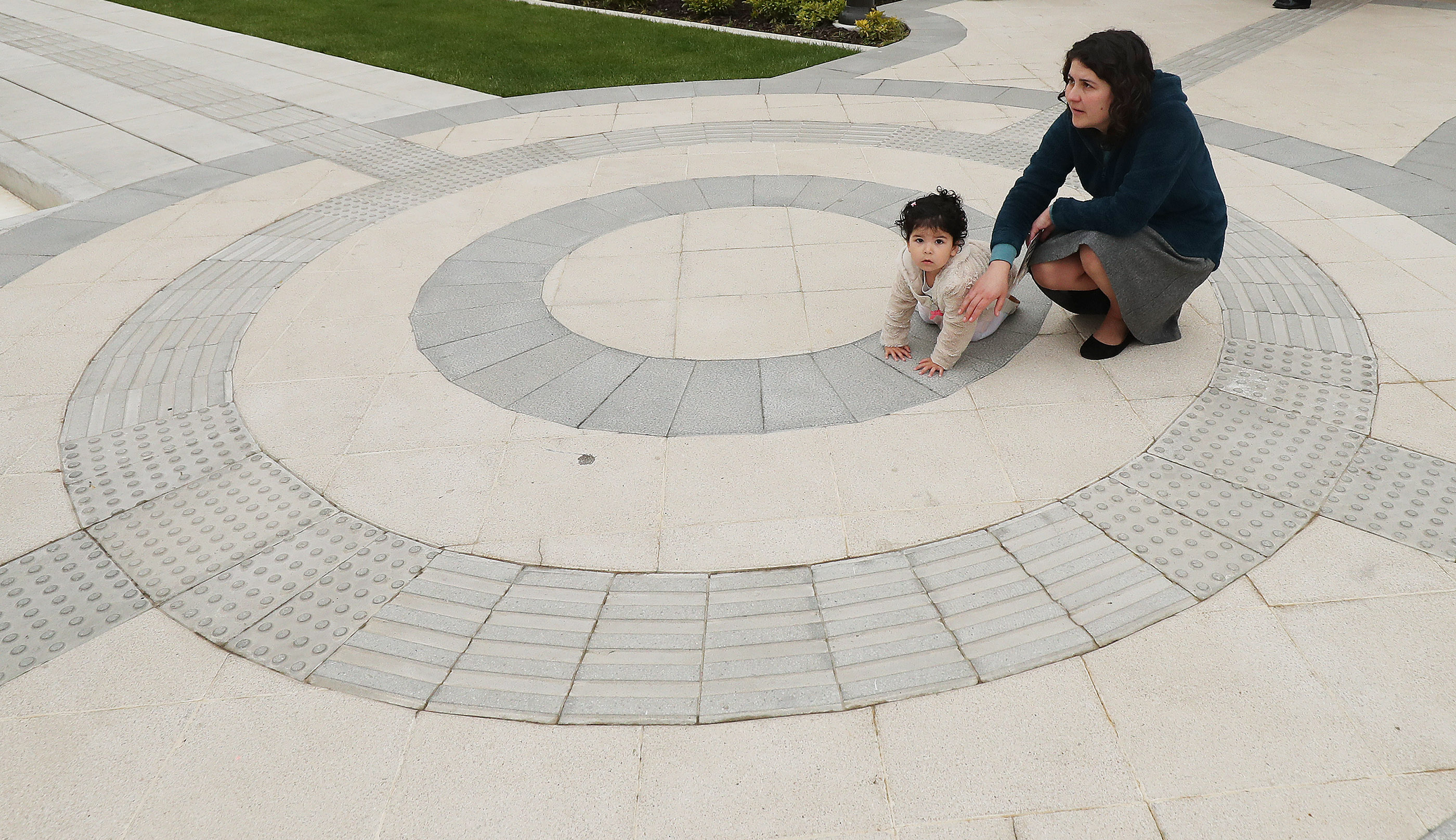 Aracely Gomez plays with her baby, Elena Gonzalez, during the dedication of the Concepcion Chile Temple in Concepcion, Chile, on Sunday, Oct. 28, 2018.