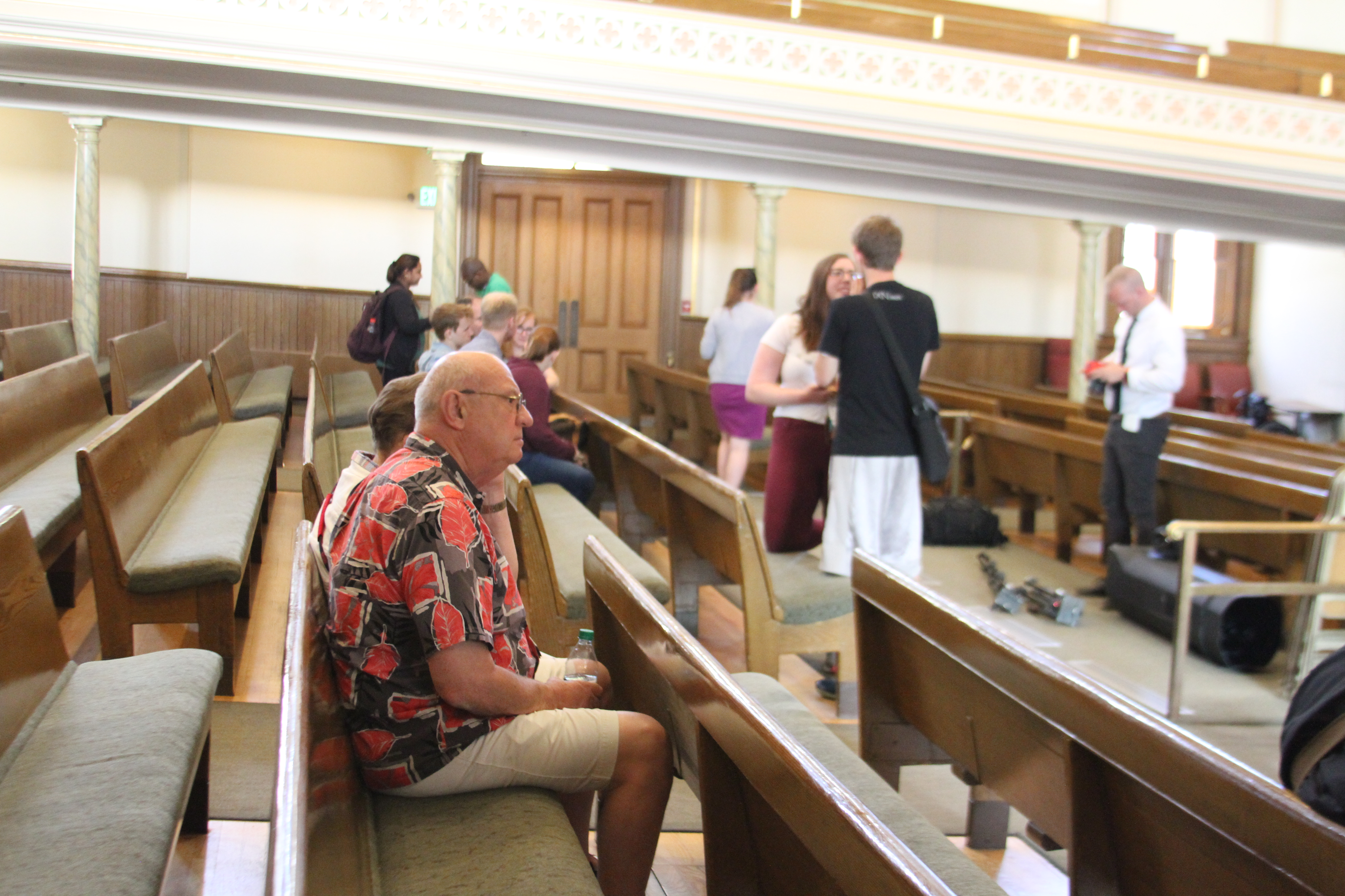 Attendees slowly file into the Assembly Hall on Temple Square and wait for Elder Kent F. Richards, emeritus General Authority Seventy, to speak at an LDSBC devotional address on Tuesday, June 11, 2019.