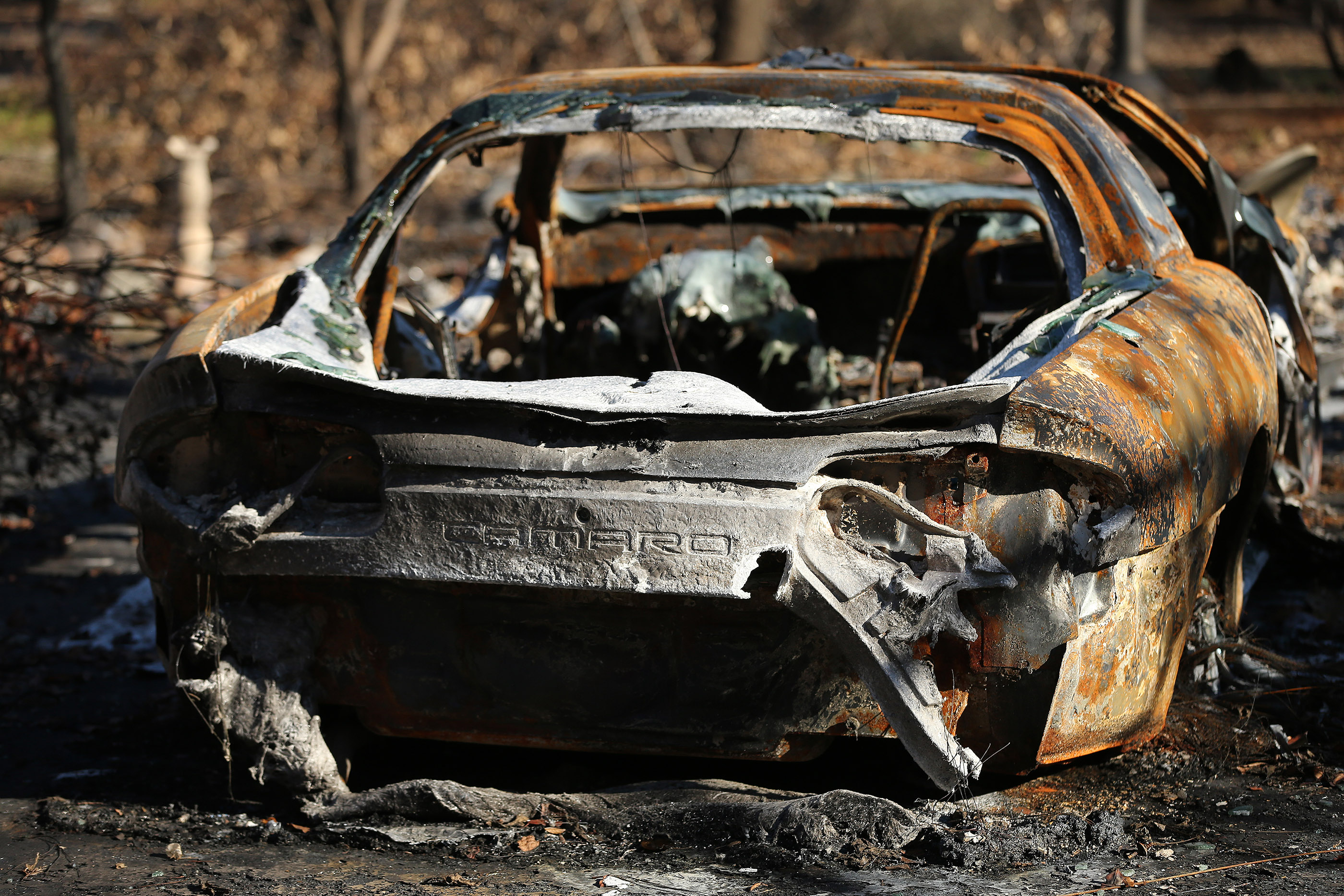 A burned-out Camaro remains on Sunday, Jan. 13, 2019, in Paradise, California, after being destroyed in the Camp Fire.