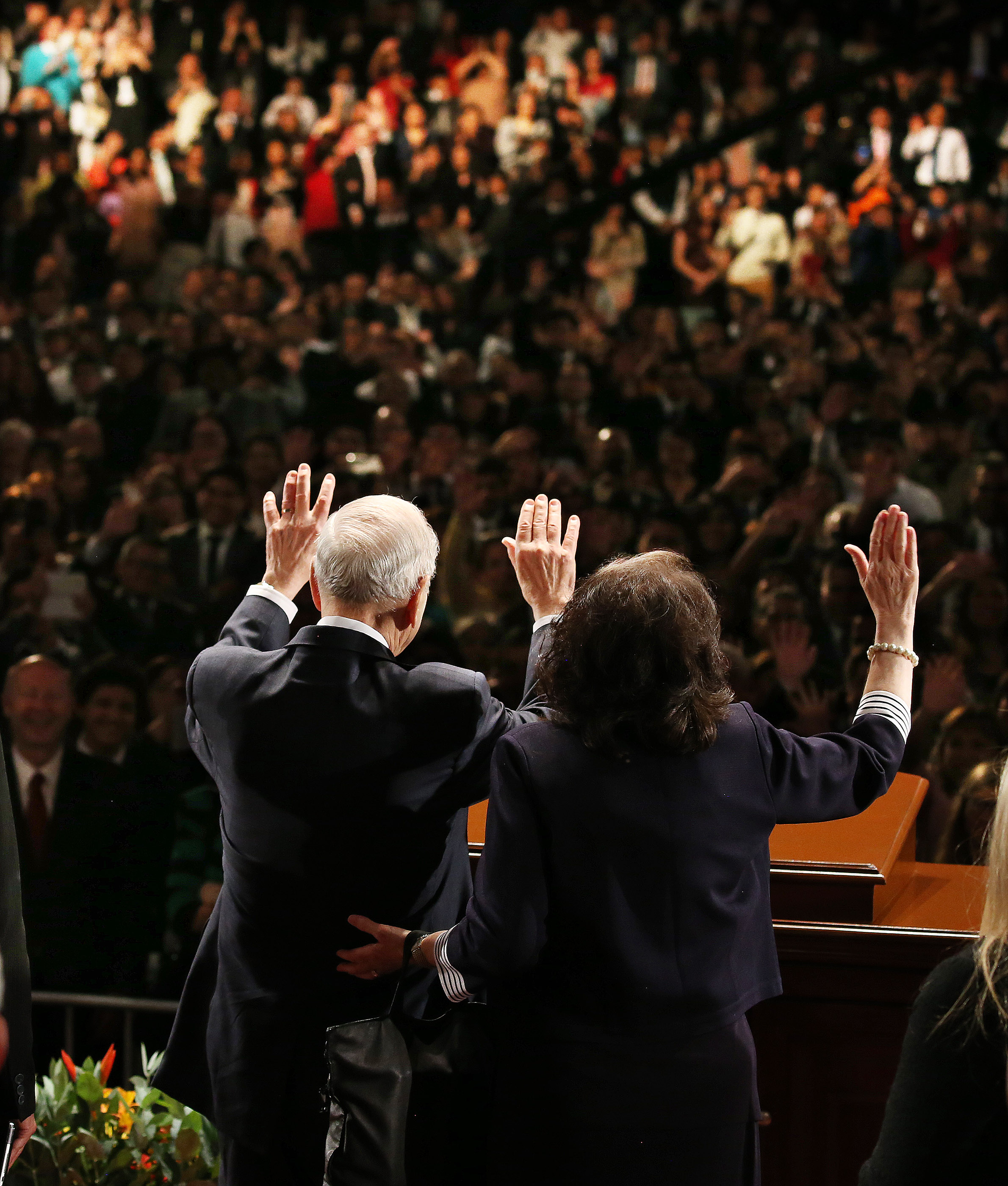 President Russell M. Nelson of The Church of Jesus Christ of Latter-day Saints and his wife, Sister Wendy Nelson, wave to attendees after a devotional in Lima, Peru, on Oct. 20, 2018.