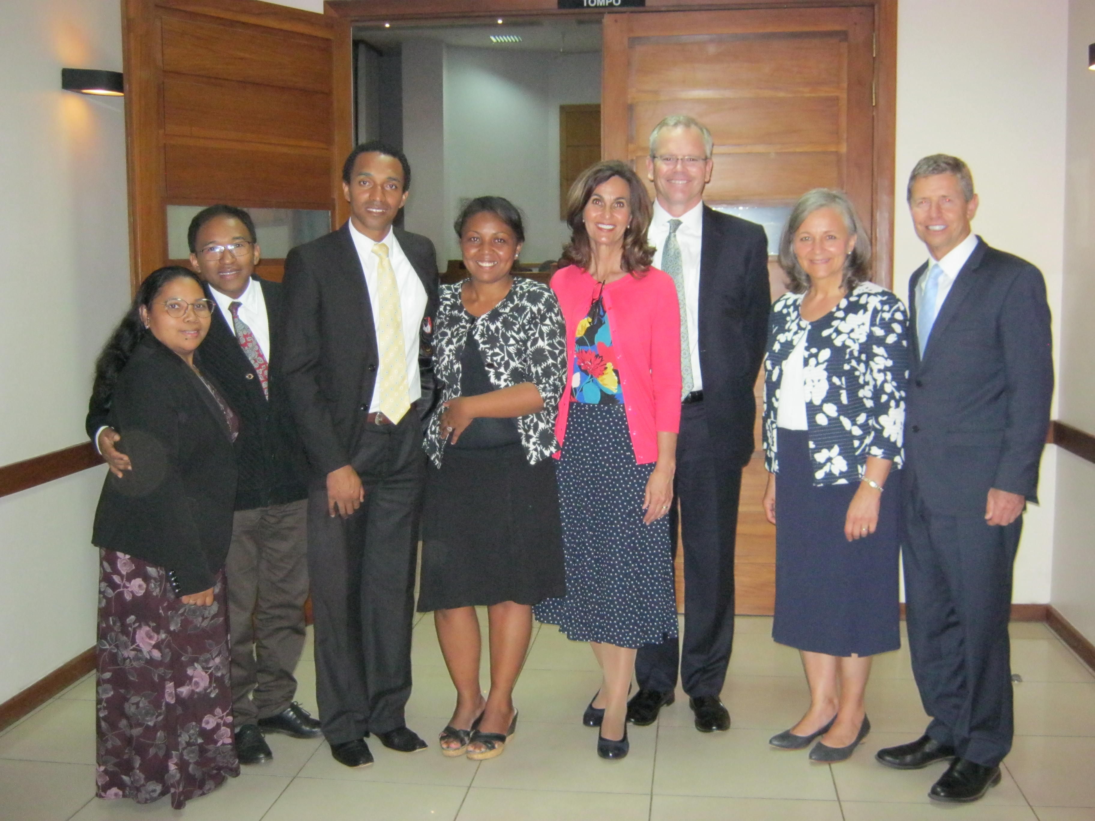 Sister Lisa L. Harkness, first counselor in the Primary general presidency, fourth from right, with her husband, David Harkness, are joined by Elder S. Mark Palmer, right, Africa Southeast Area president and his wife, Sister Jacqueline Palmer, in a photo with leaders and wives in Madagascar.