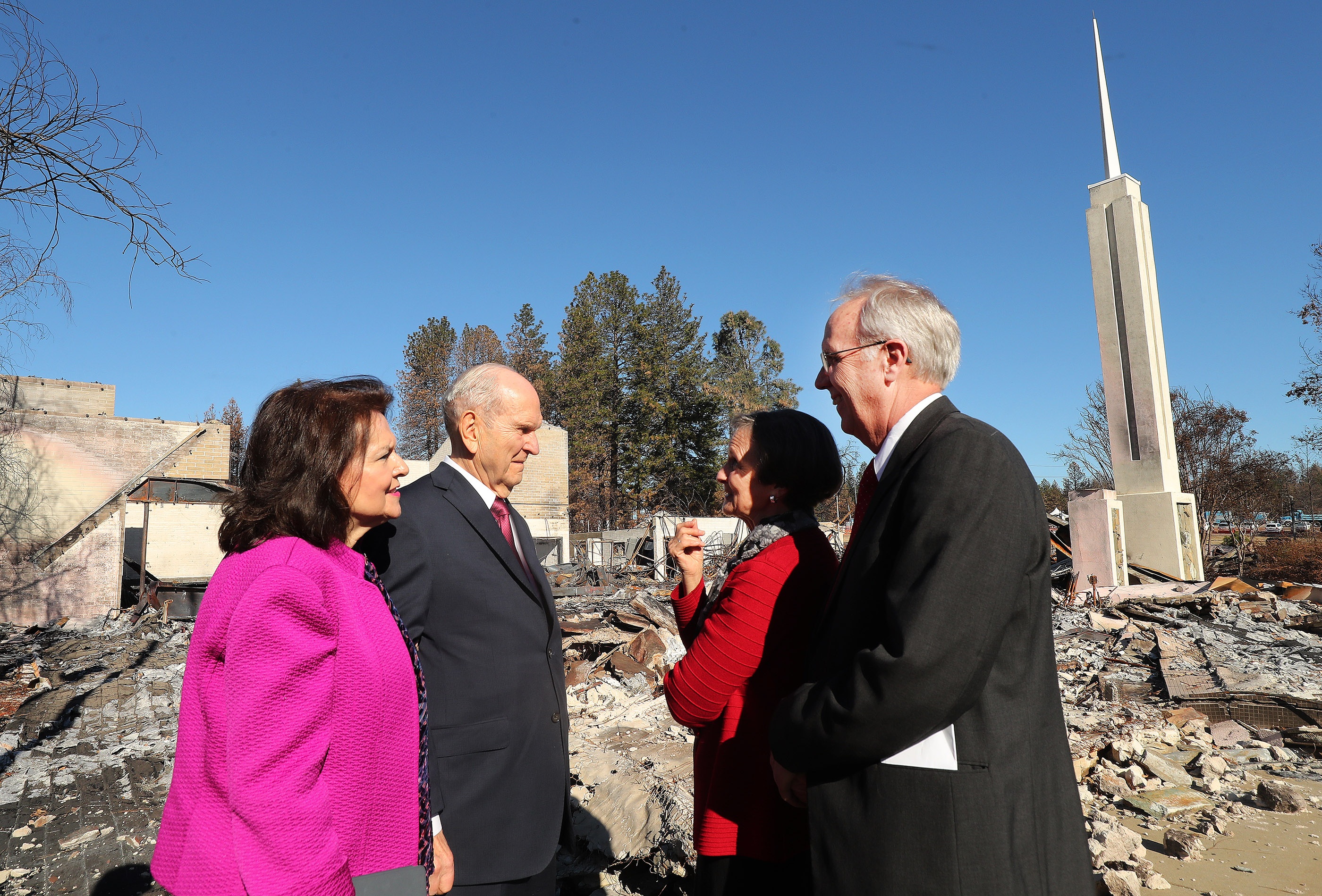 President Russell M. Nelson of The Church of Jesus Christ of Latter-day Saints and his wife, Sister Wendy Nelson, talk with fire victims Rick and Kathie Turner by the burned chapel in Paradise, California, on Sunday, Jan. 13, 2019, two months after the Camp Fire destroyed 1,400 homes and hundreds of businesses.