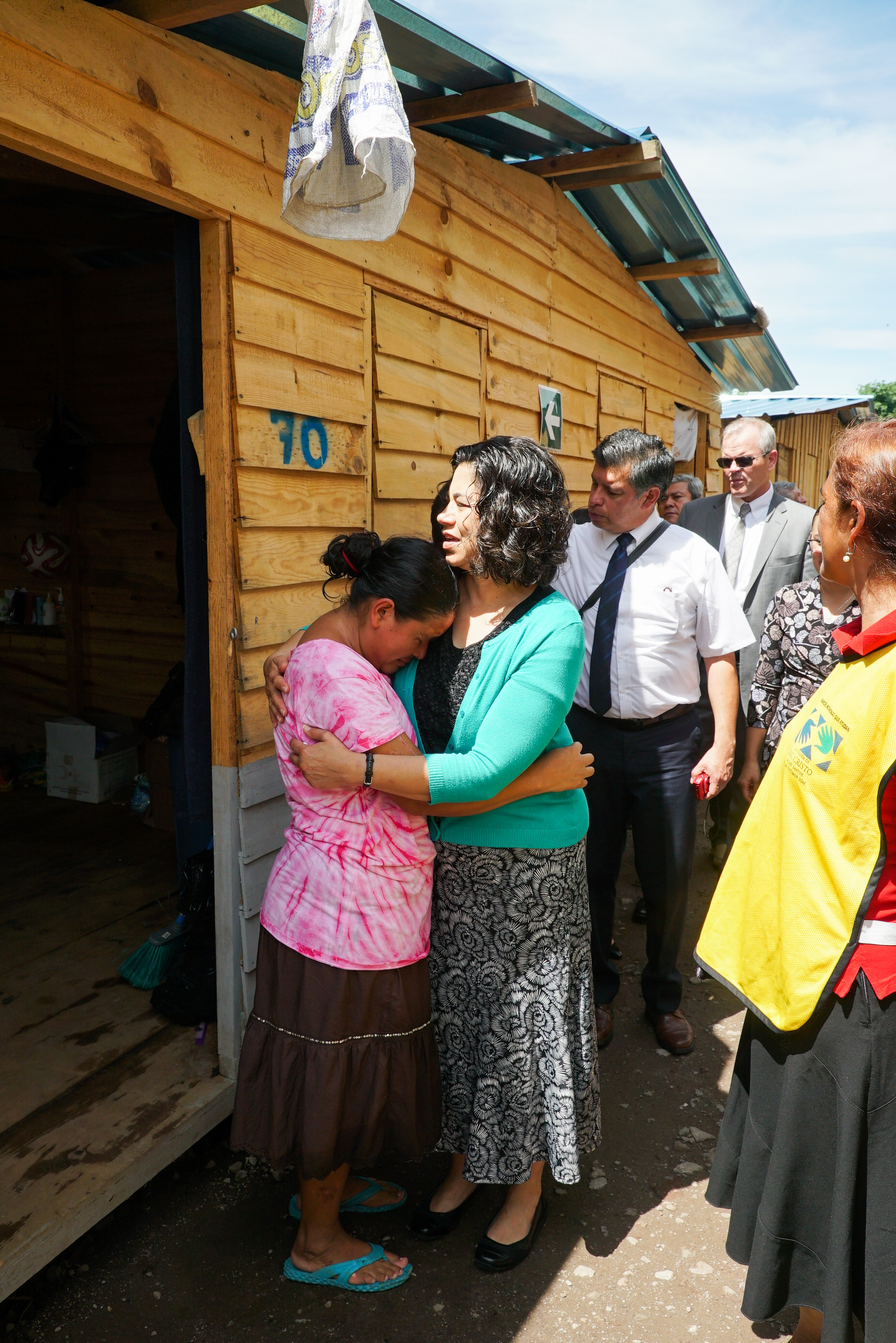 Sister Reyna Isabel Aburto, second counselor in the Relief Society general presidency, comforts a volcano survivor in Escuintla, Guatemala, Wednesday, Aug. 29, 2018.