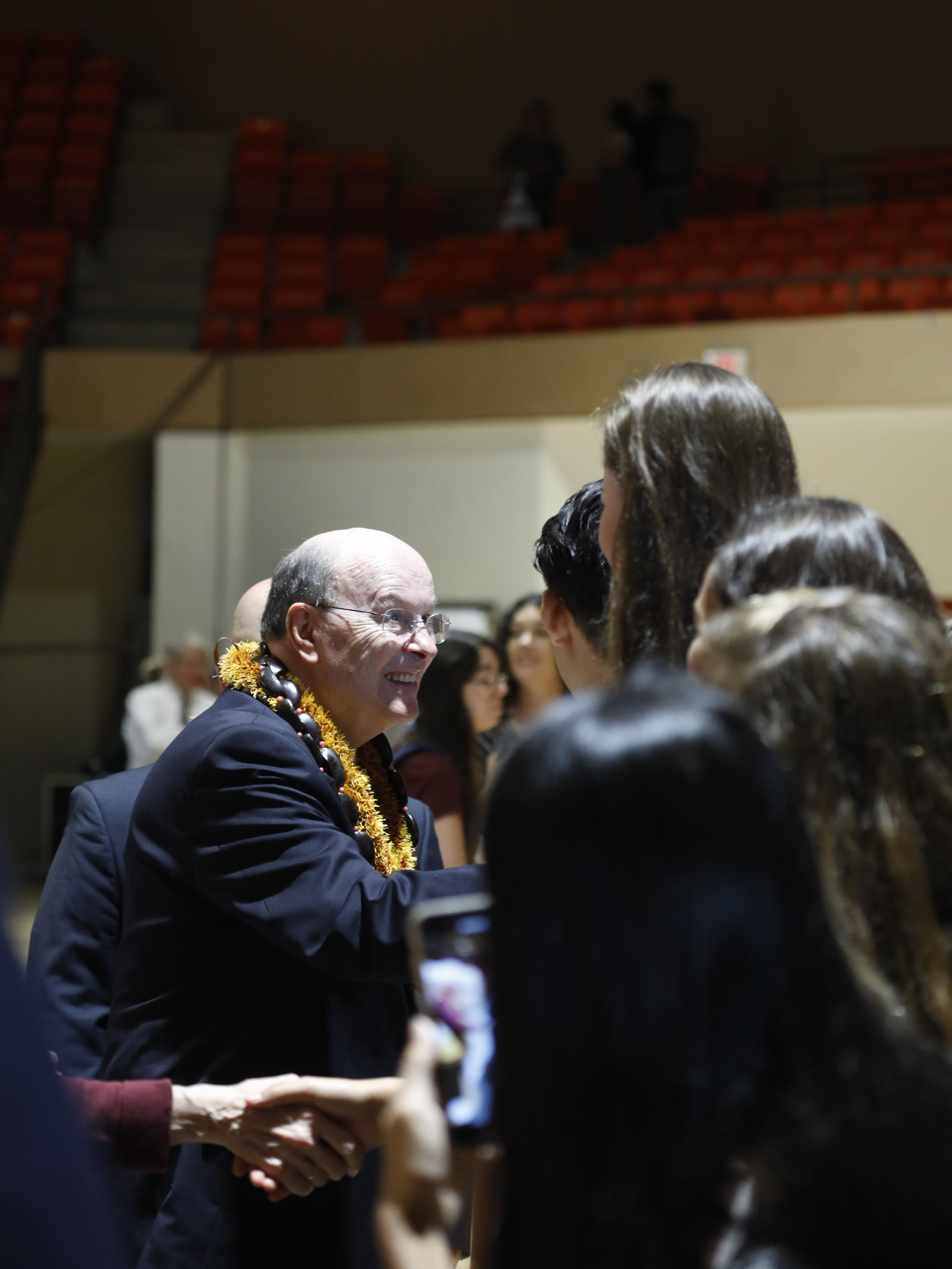 Elder Quentin L. Cook of the Quorum of the Twelve Apostles greets students at a campus devotional at BYU-Hawaii on Nov. 20.