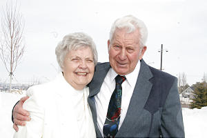 XXX XXXXX and XXXX of Ashton, Idaho, stand in line for dedication. He joined the Church after meeting her 50 years ago.