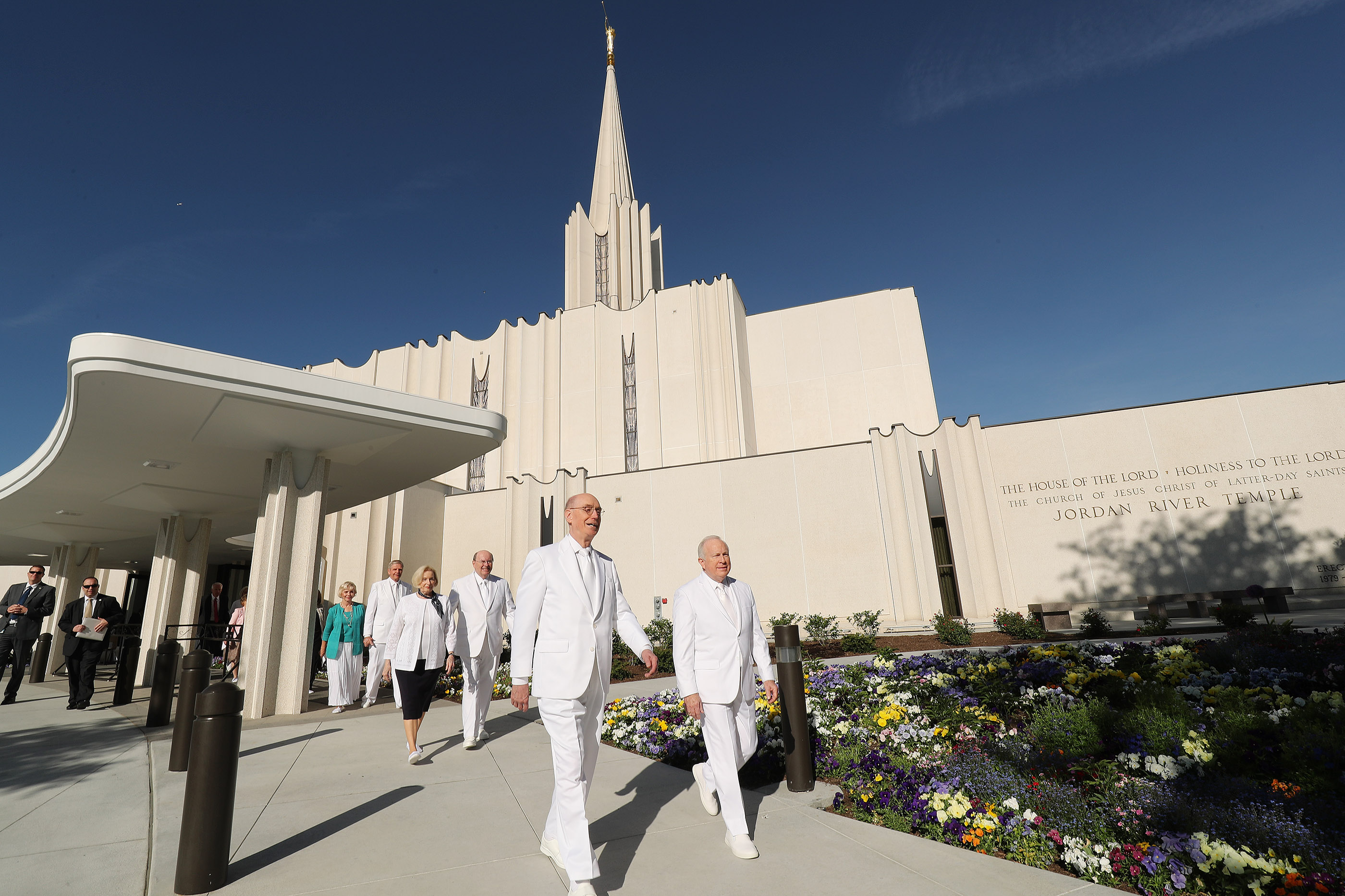 Henry B. Eyring, second counselor in the First Presidency, and Quentin L. Cook of the Quorum of the Twelve walk outside the Jordan River Utah Temple during rededication in South Jordan on Sunday, May 20, 2018.