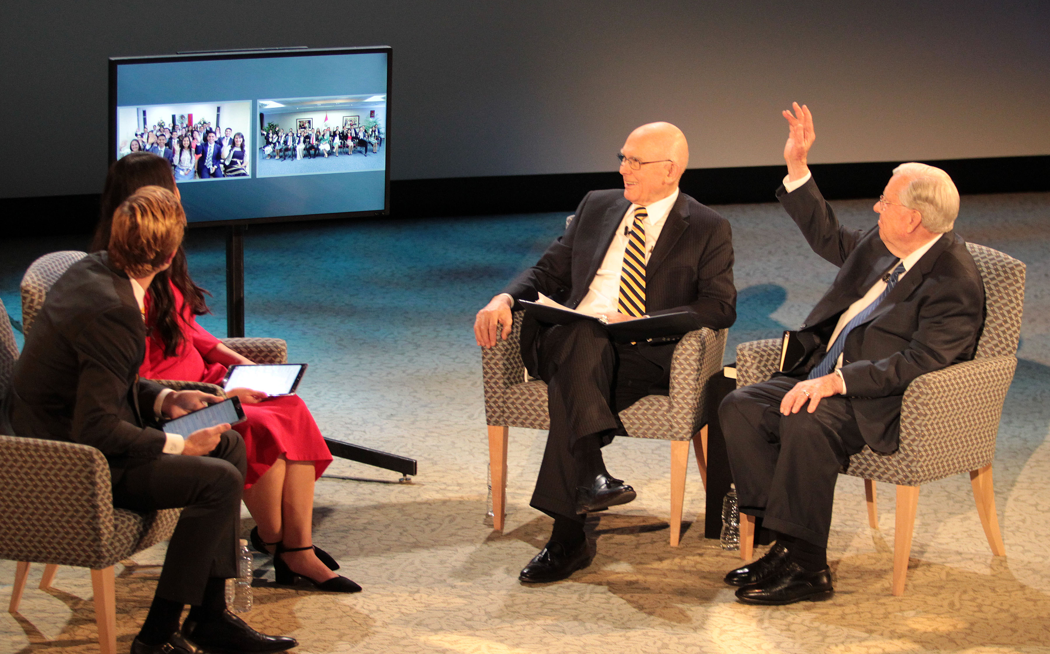 President Dallin H. Oaks and President M. Russell Ballard of the Quorum of the Twelve Apostles answer questions from young single adults during a Face to Face event on Nov. 20, 2017, in Logan, Utah.