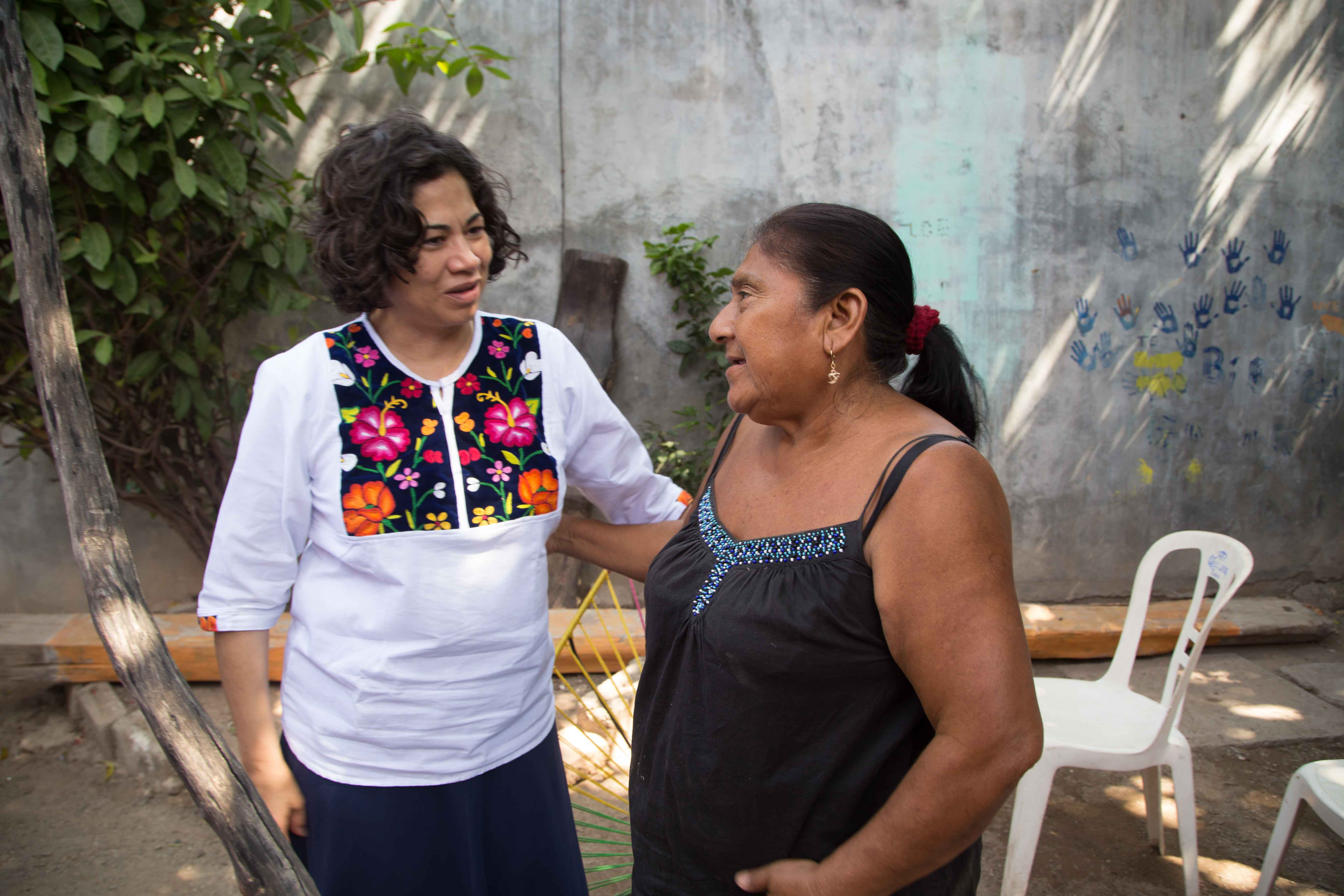 Sister Reyna Isabel Aburto, second counselor in the Relief Society general presidency, visits with earthquake survivors in Juchitán de Zaragoza, Oaxaca, Mexico, Friday, Nov. 3, 2017.