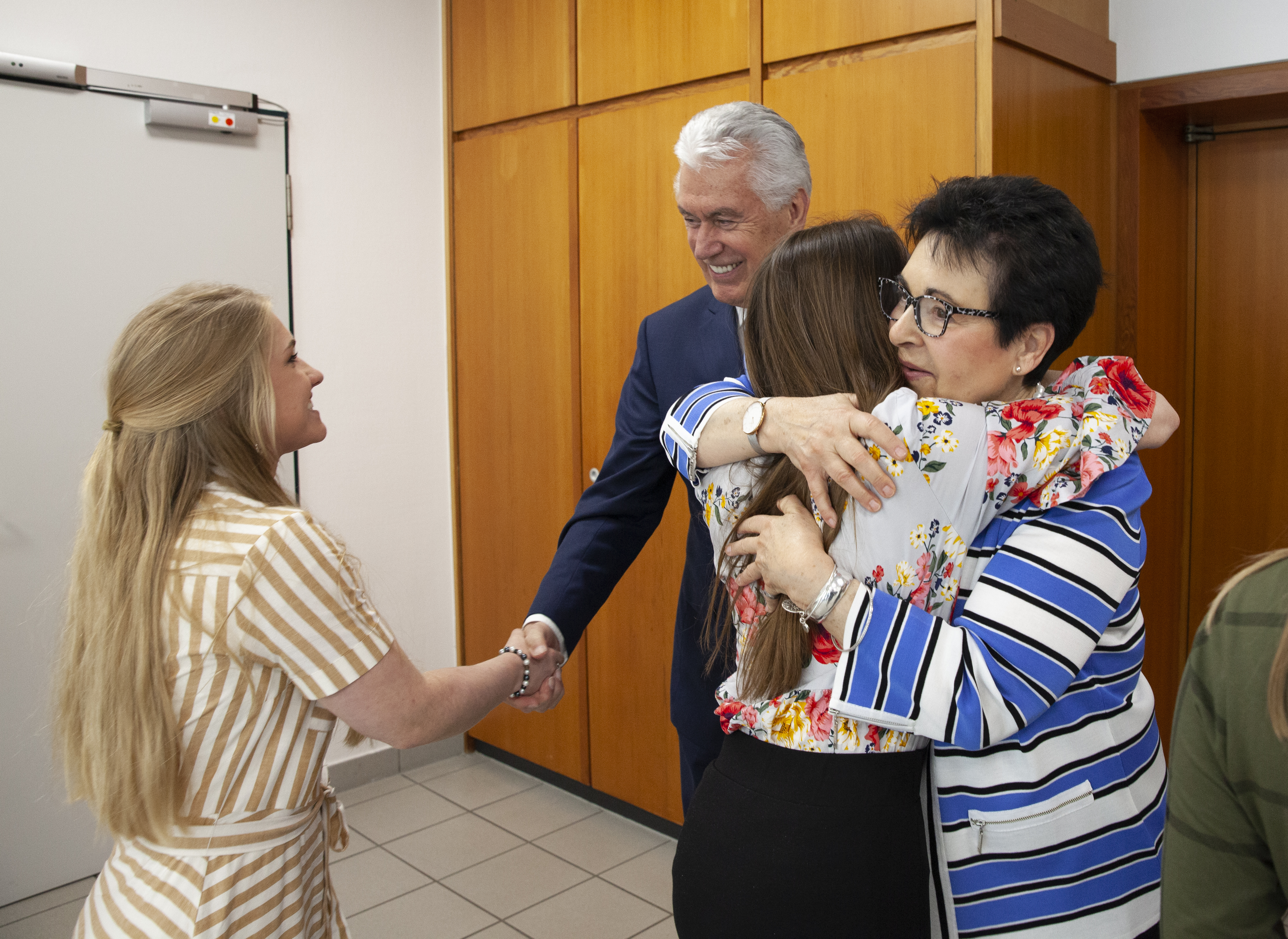 Elder Dieter F. Uchtdorf and Sister Harriet Uchtdorf greet missionaries of the Germany Frankfurt Mission following a mission conference in Frankfurt on April 26, 2019.