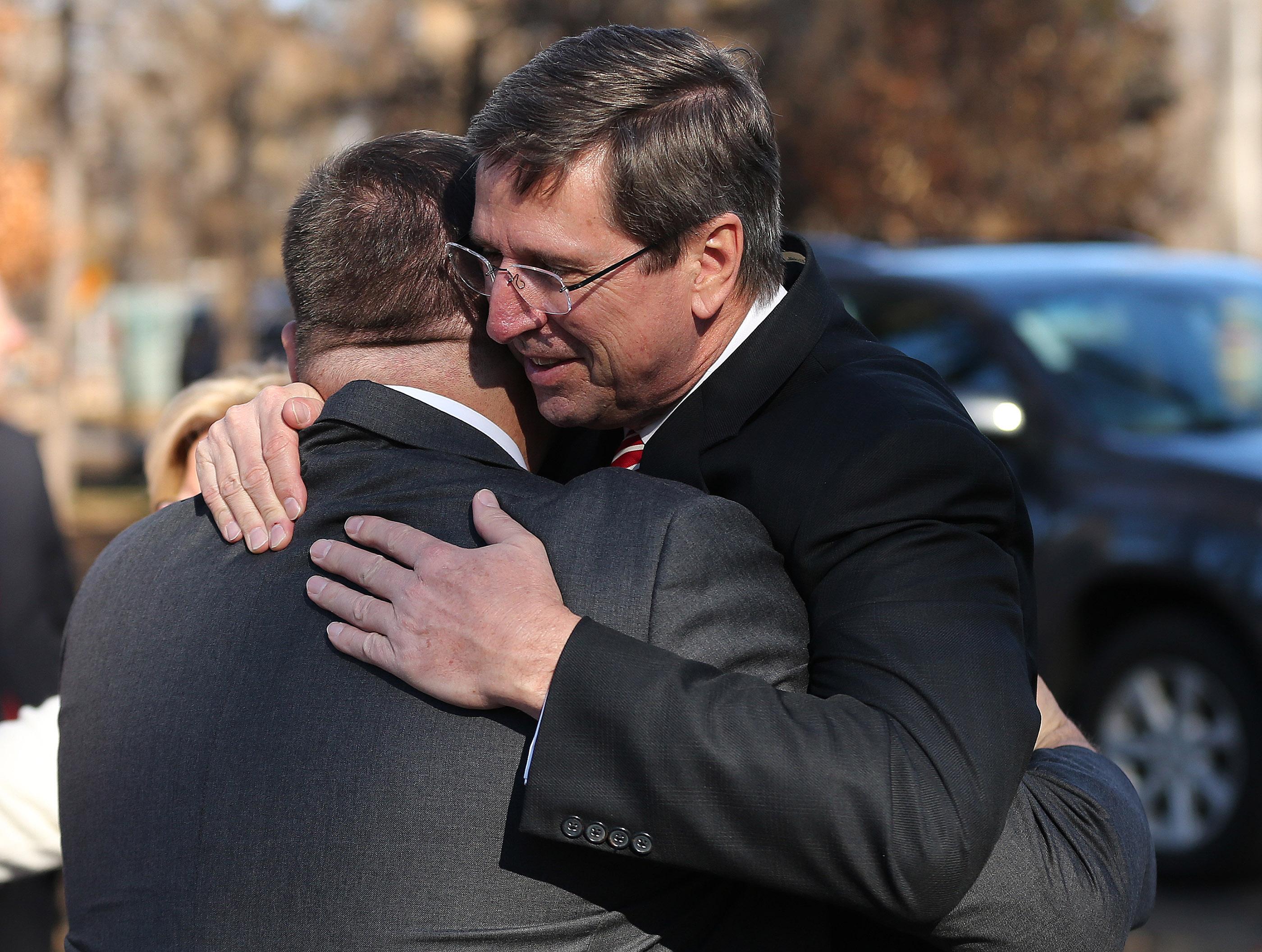 Elder Kevin W. Pearson, right, a General Authority Seventy of The Church of Jesus Christ of Latter-day Saints, hugs fire victim Robert Harrison in Paradise, California, on Sunday, Jan. 13, 2019.