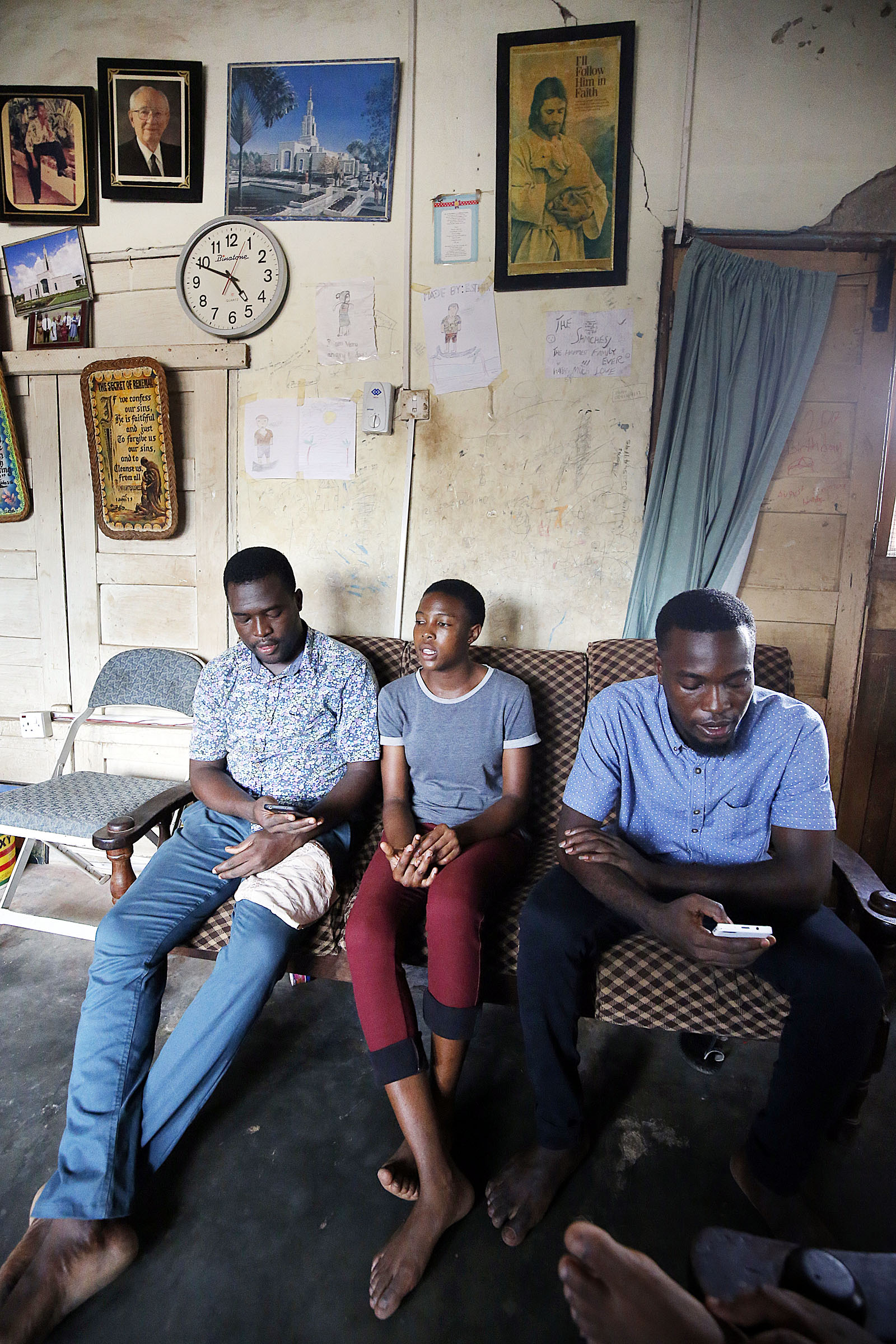 Simmons, left, Dora and Martin Samche sing together before studying scriptures as a family at their home in Kumasi, Ghana, on Saturday, April 21, 2018.