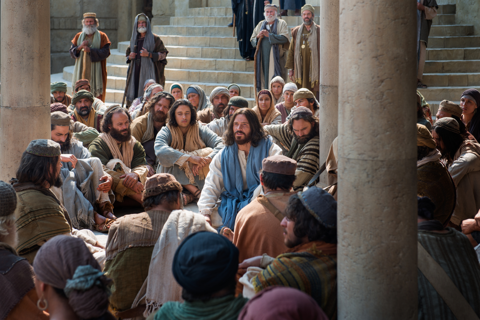 An image from the Church's Bible video series depicts Christ teaching a group of people.